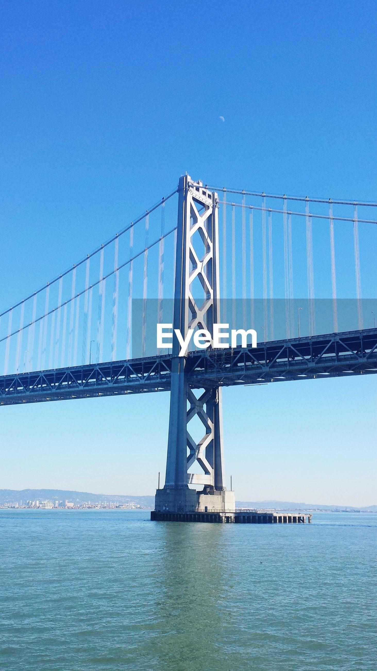 Bay bridge against clear blue sky