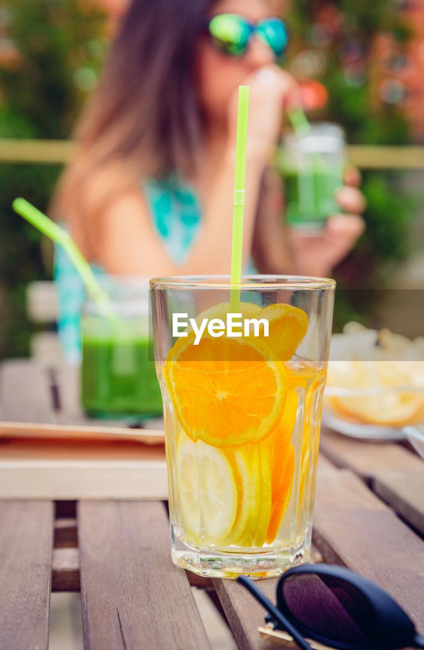 Woman having orange juice in restaurant