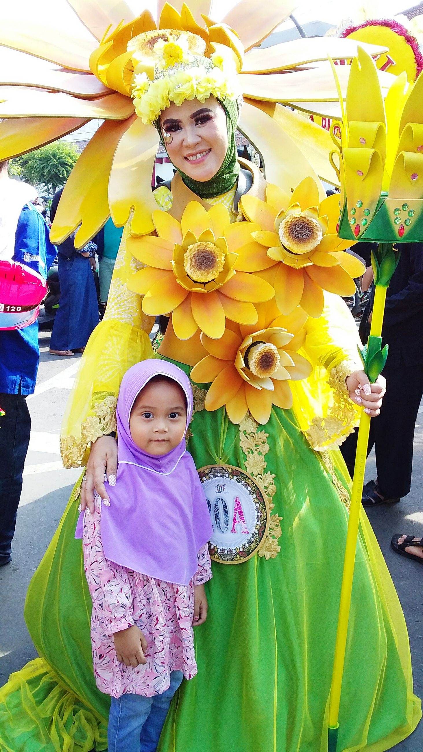 Portrait of woman wearing costume standing by daughter during traditional festival
