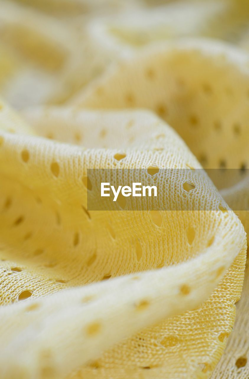 close-up, no people, yellow, pattern, selective focus, indoors, backgrounds, still life, full frame, water, textured, detail, textile, freshness, animal wildlife, nature, white color, natural pattern, marine