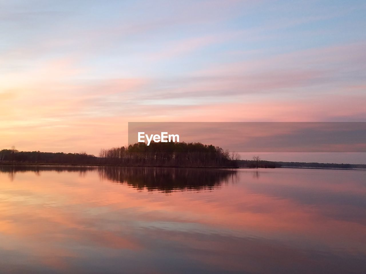 sky, reflection, sunset, beauty in nature, scenics - nature, tranquility, water, tranquil scene, lake, cloud - sky, waterfront, nature, no people, idyllic, orange color, non-urban scene, tree, silhouette, symmetry, outdoors, reflection lake