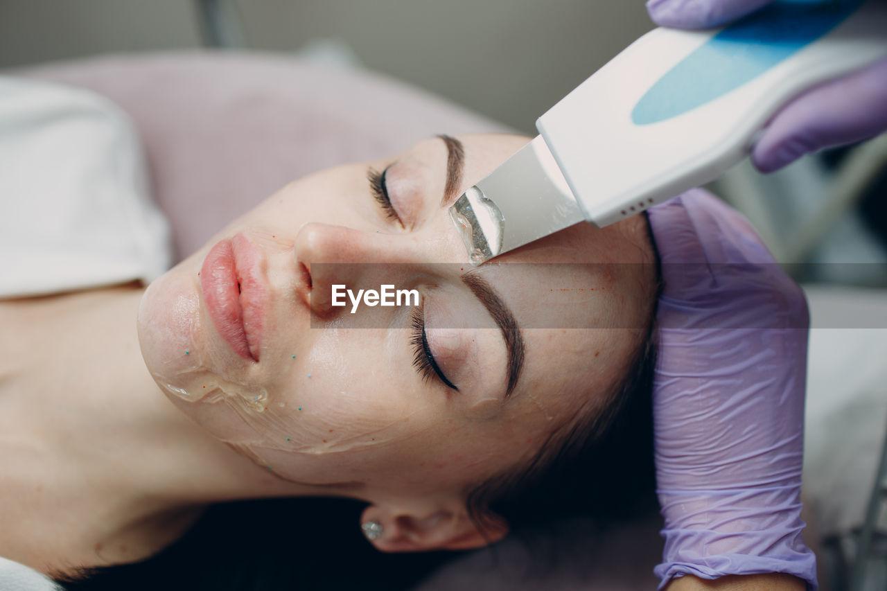 Close-up of woman having beauty treatment at spa