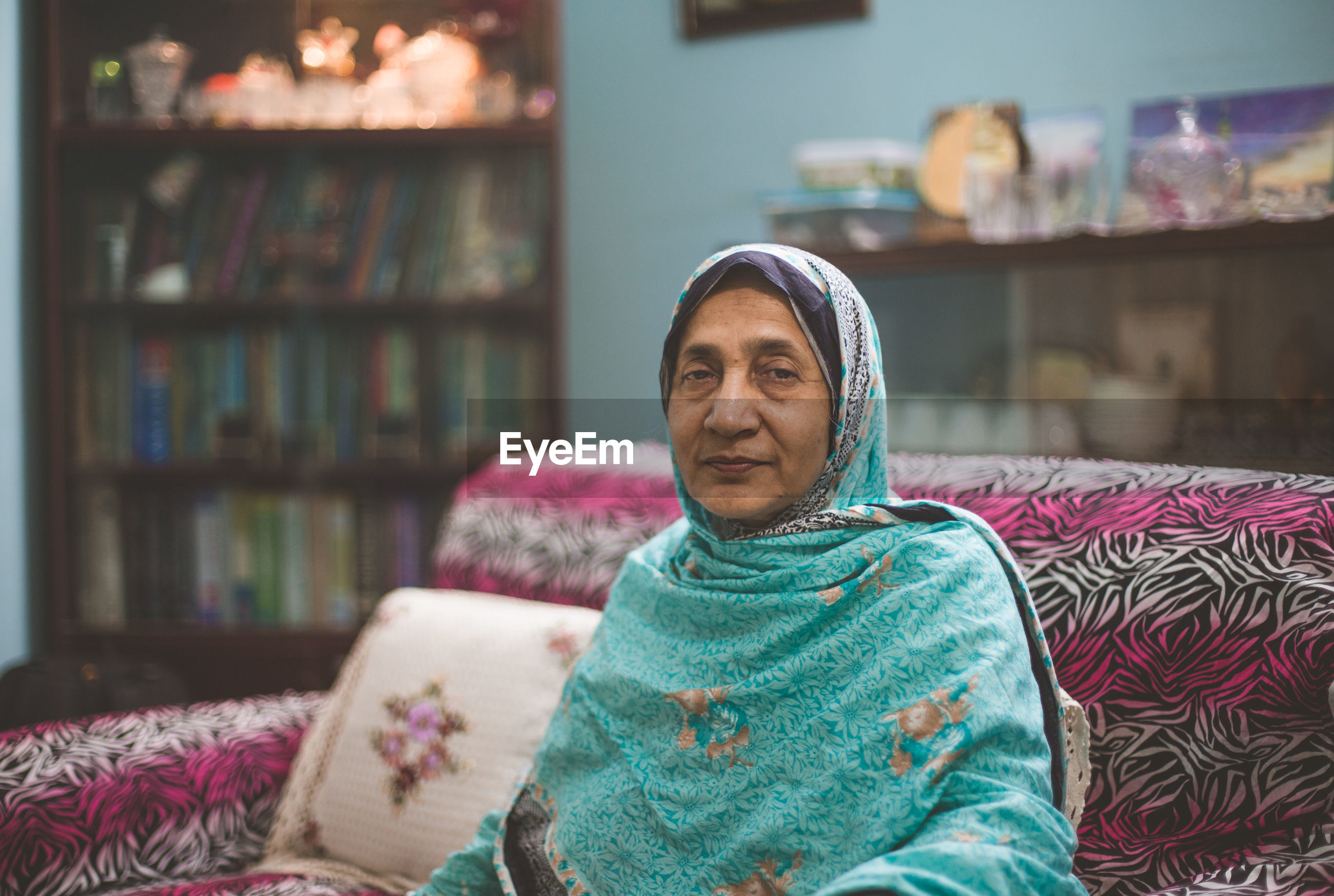 Portrait of senior woman sitting on sofa at home