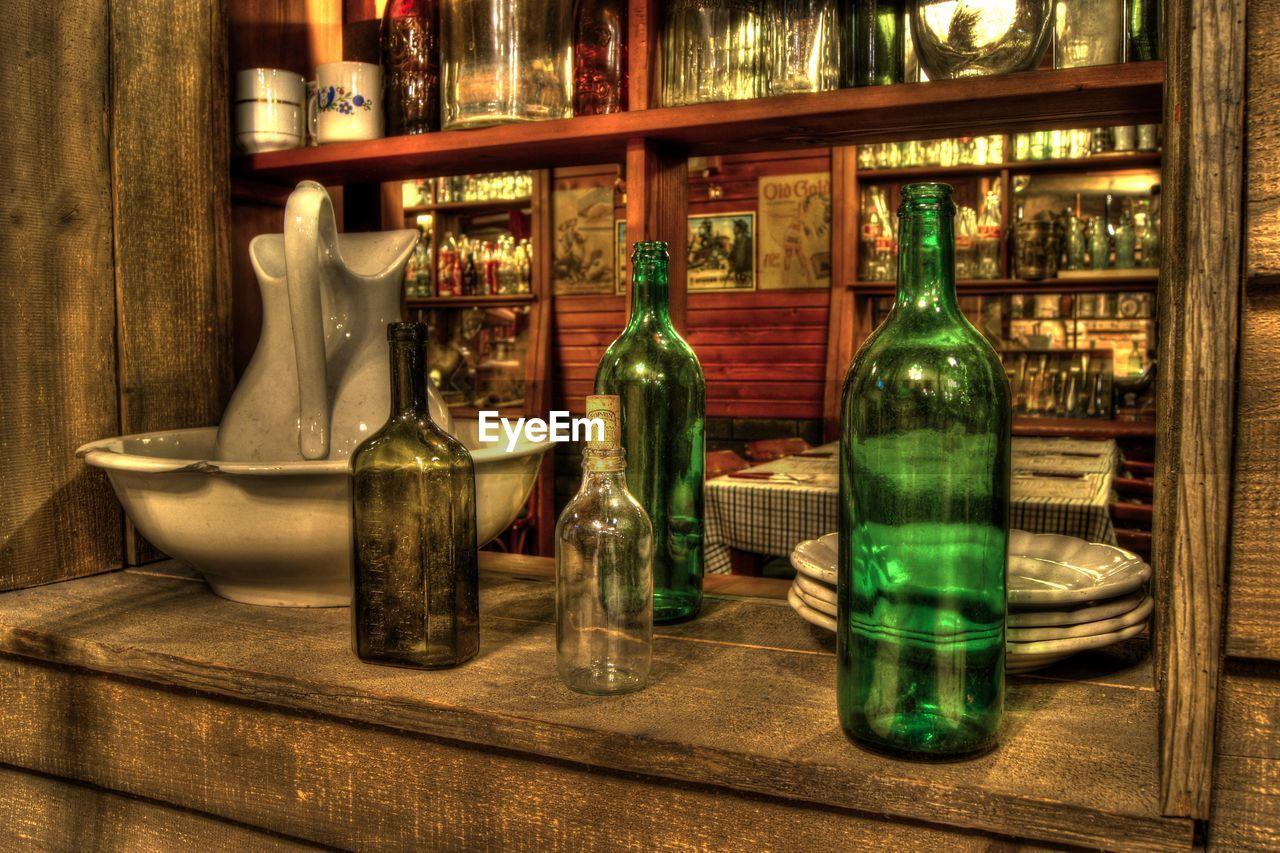 bottle, shelf, indoors, variation, no people, large group of objects, arrangement, alcohol, day