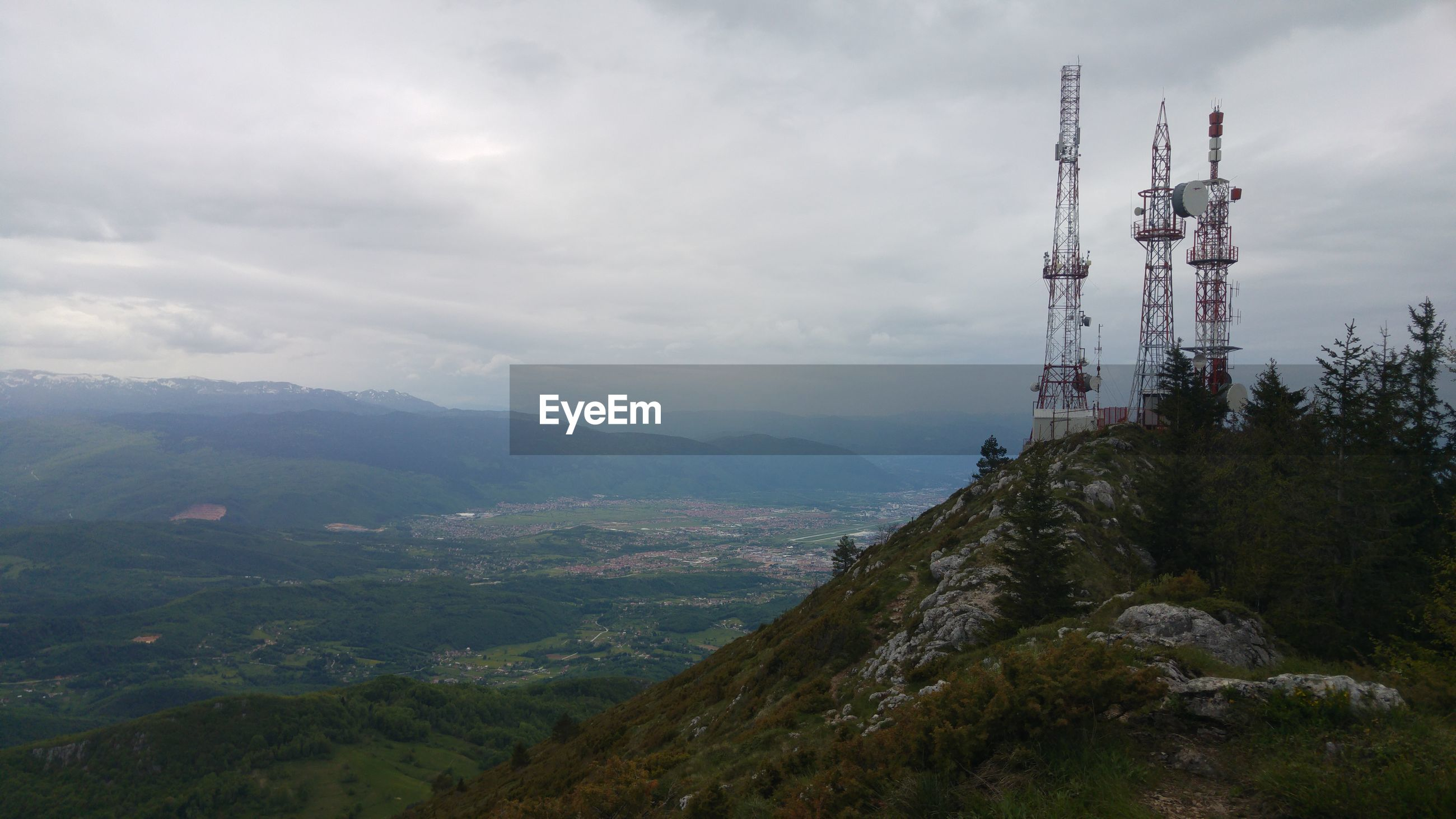 Aerial view of communications tower and mountains against sky