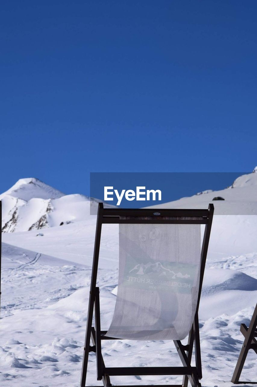 Snow Covered Mountain Against Clear Sky
