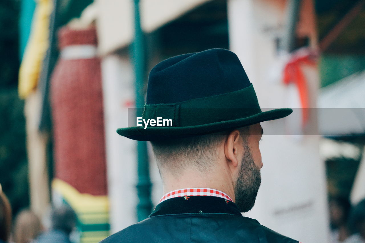 headshot, hat, real people, men, portrait, rear view, clothing, one person, focus on foreground, beard, cap, facial hair, lifestyles, leisure activity, looking, day, uniform, security, fashion, government