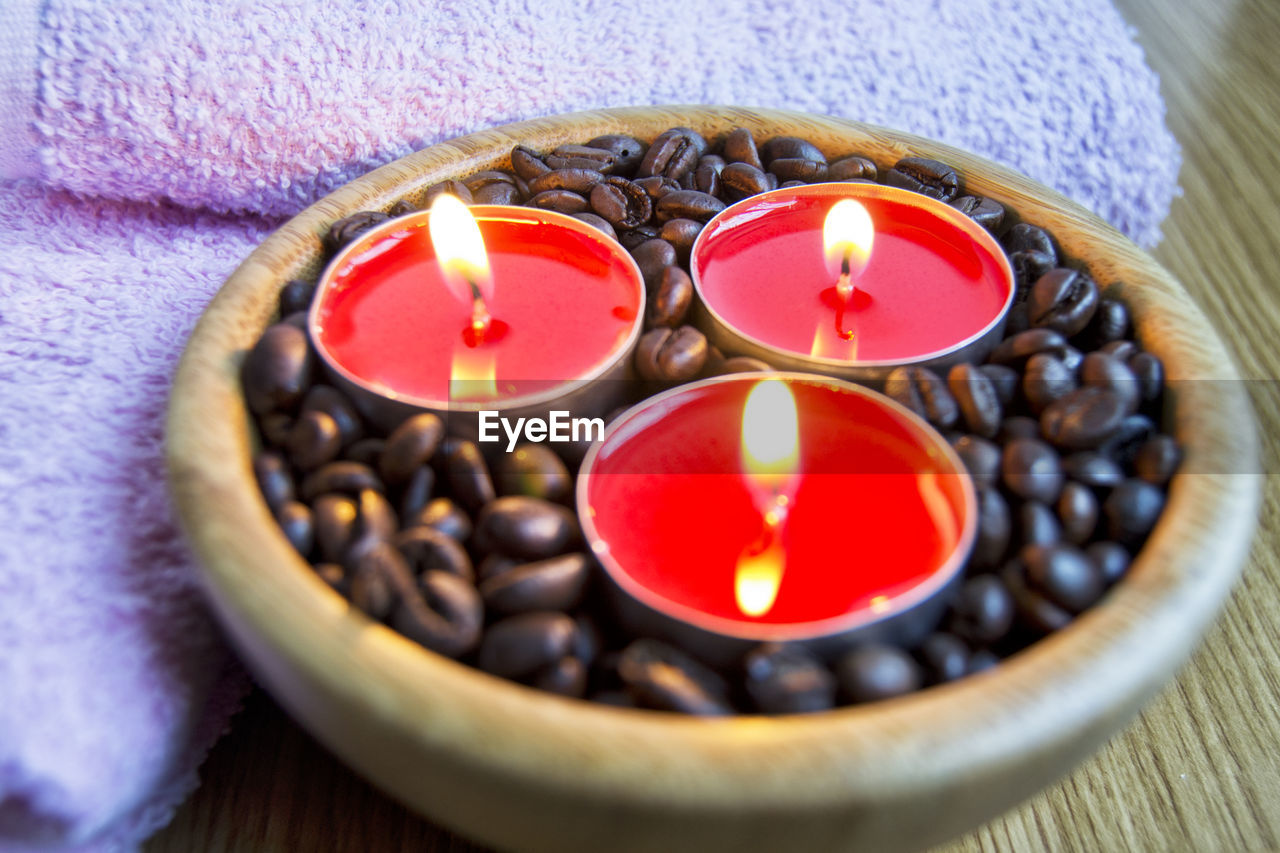 candle, flame, fire, burning, indoors, close-up, fire - natural phenomenon, tea light, wellbeing, no people, illuminated, nature, healthy lifestyle, flower, heat - temperature, selective focus, high angle view, healthcare and medicine, red, beauty in nature, aromatherapy