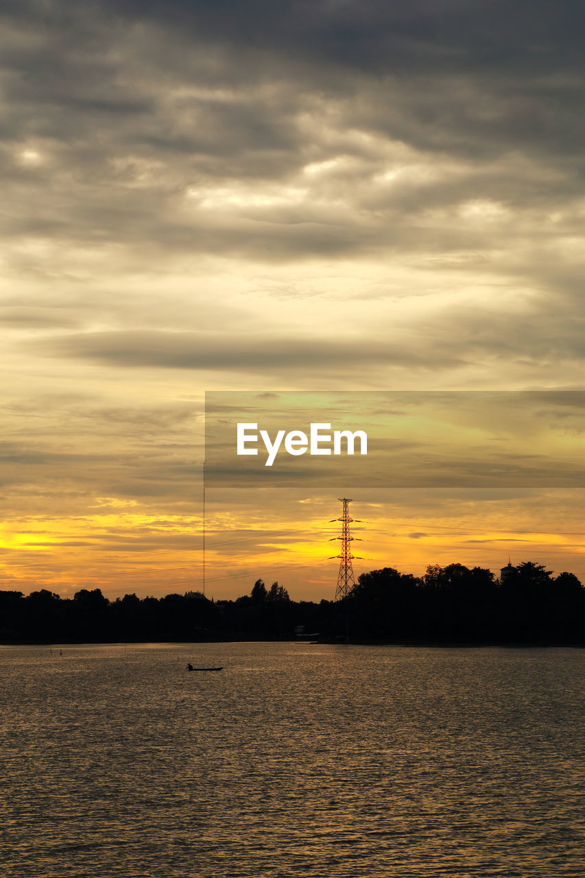 sunset, sky, cloud - sky, beauty in nature, scenics - nature, orange color, waterfront, silhouette, water, no people, nature, fuel and power generation, technology, non-urban scene, electricity, tranquility, tranquil scene, outdoors, electricity pylon, power supply