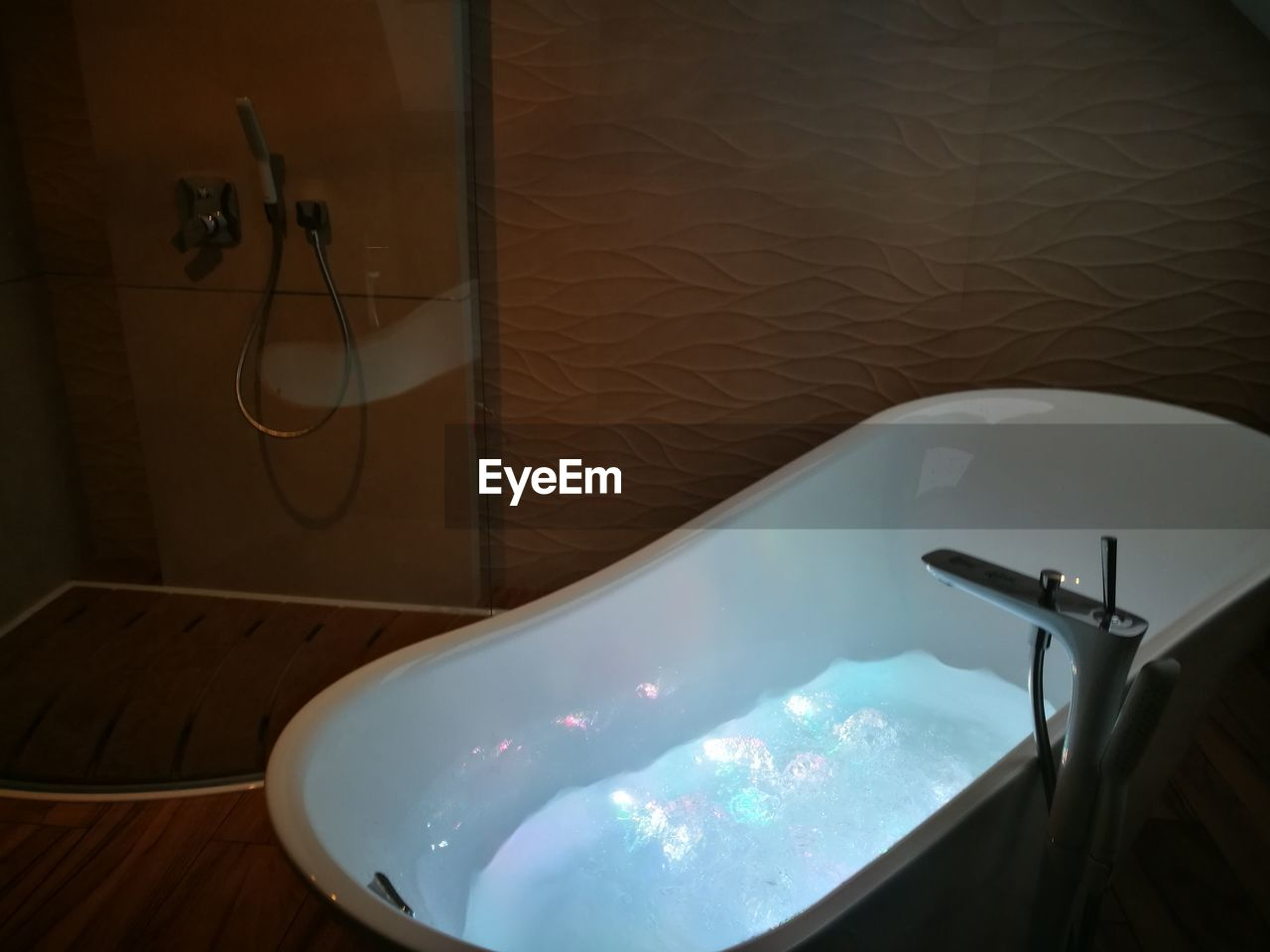 indoors, domestic bathroom, bathroom, bathtub, domestic room, home, no people, absence, high angle view, water, table, nature, illuminated, faucet, home interior, day, hygiene, close-up, sink, luxury, electric lamp