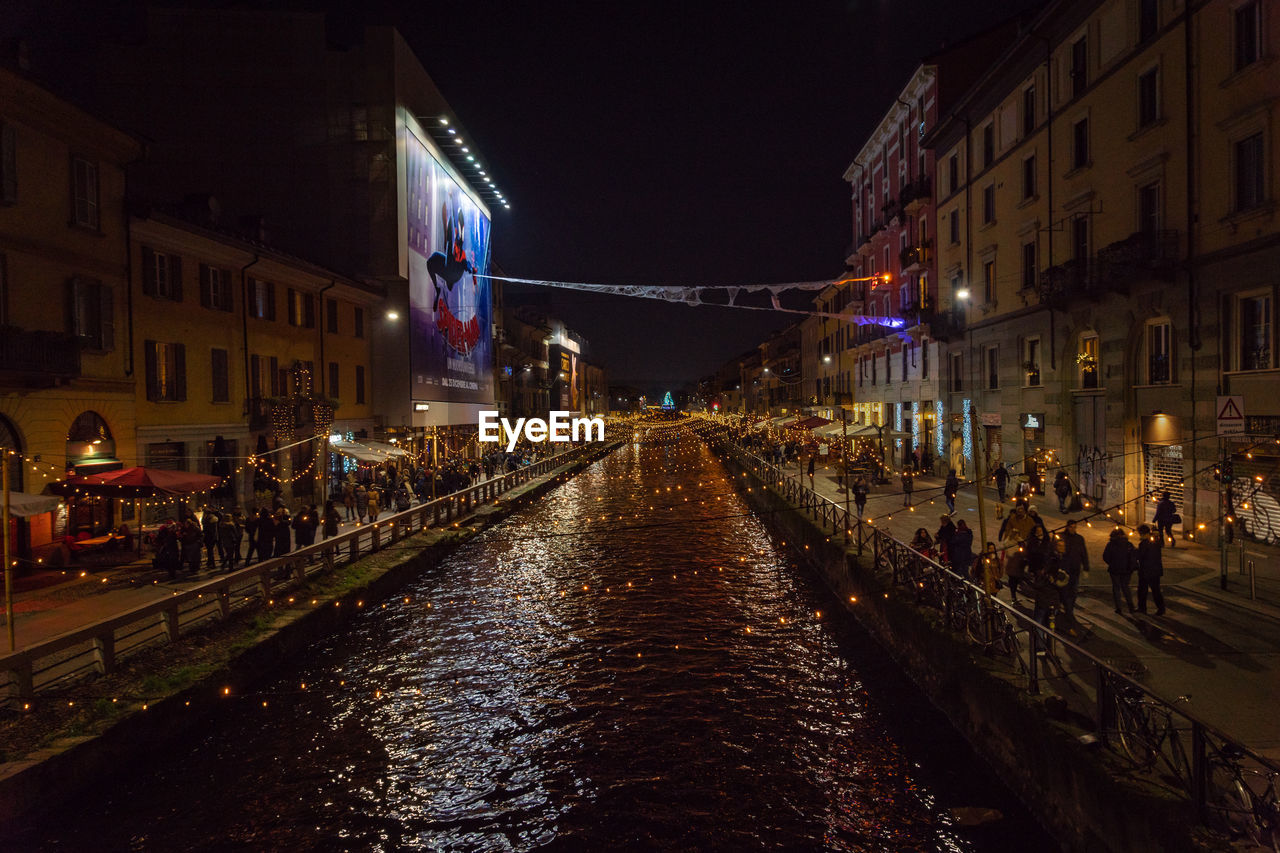 night, architecture, built structure, building exterior, illuminated, city, street, water, nature, canal, transportation, building, incidental people, diminishing perspective, the way forward, direction, lighting equipment, sky, group of people, dark