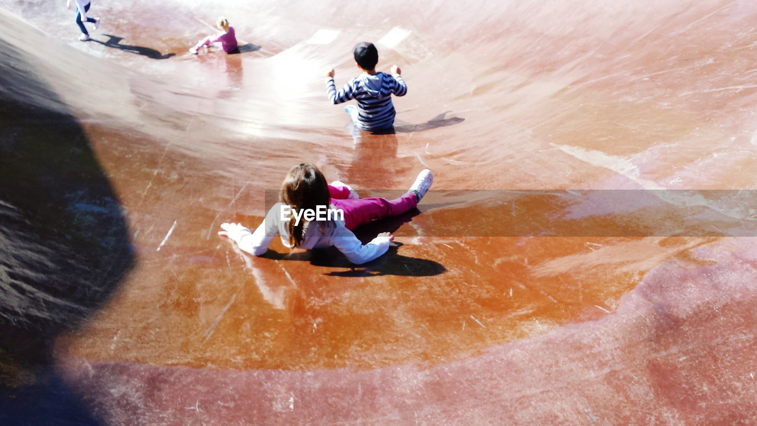 High angle view of children playing on slide
