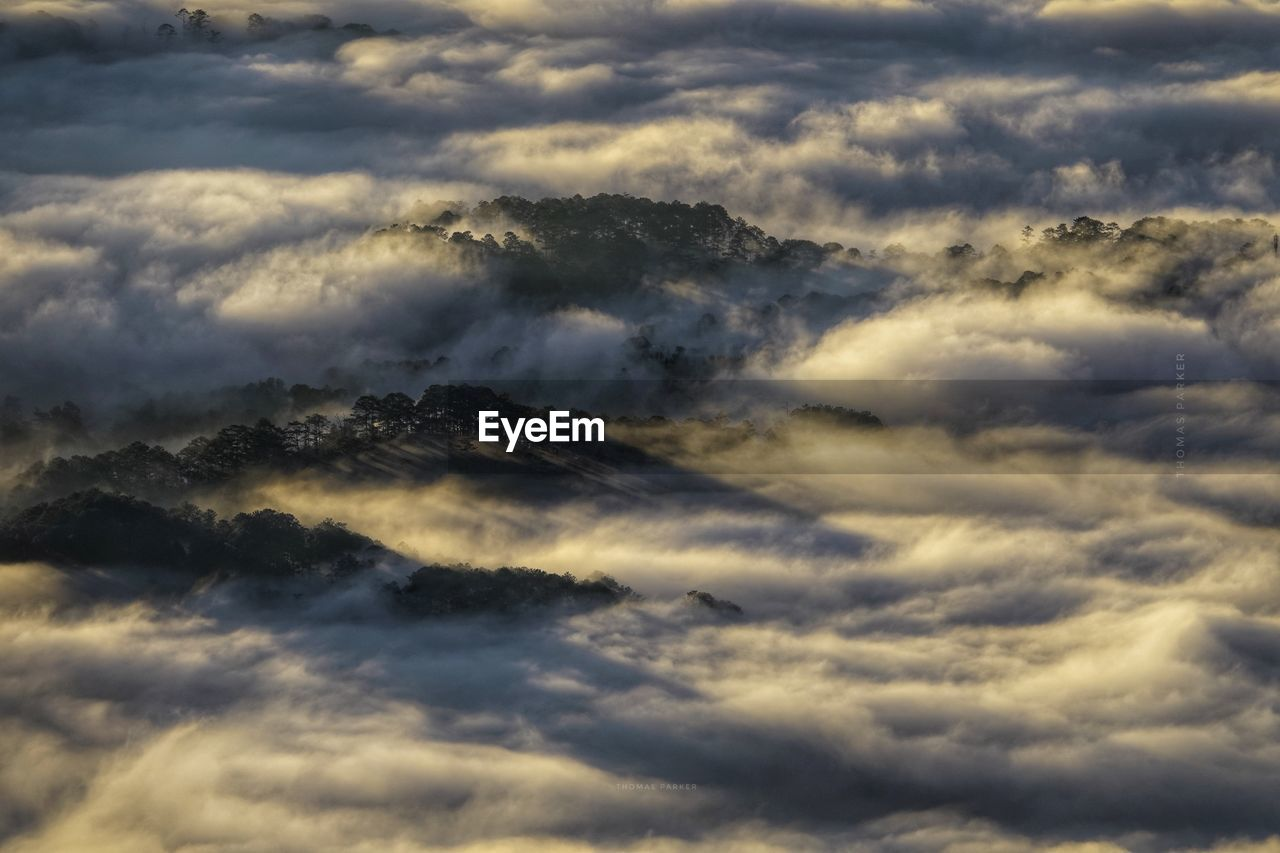 High angle view of cloudscape over mountains