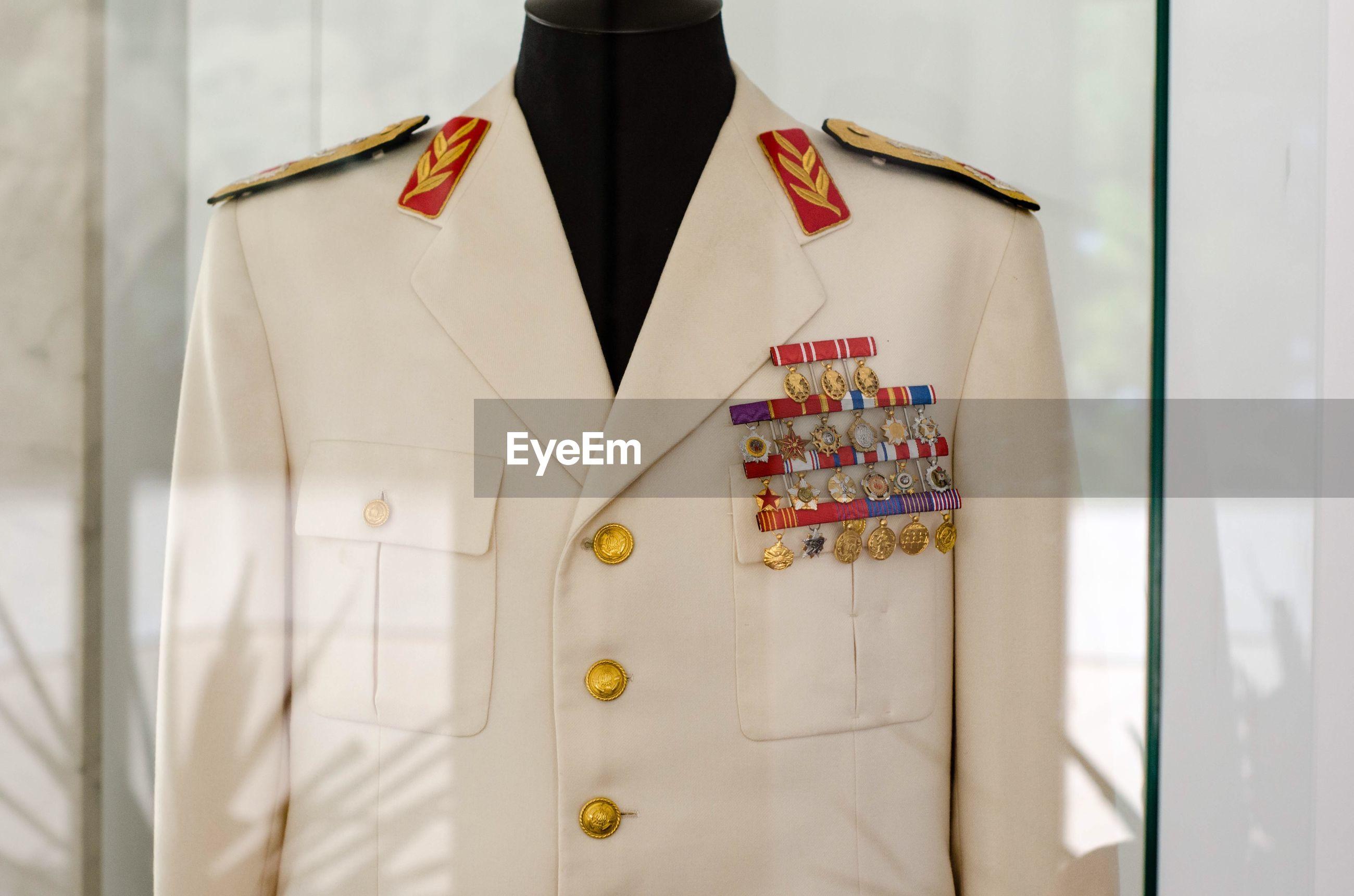 Close-up of uniform on mannequin
