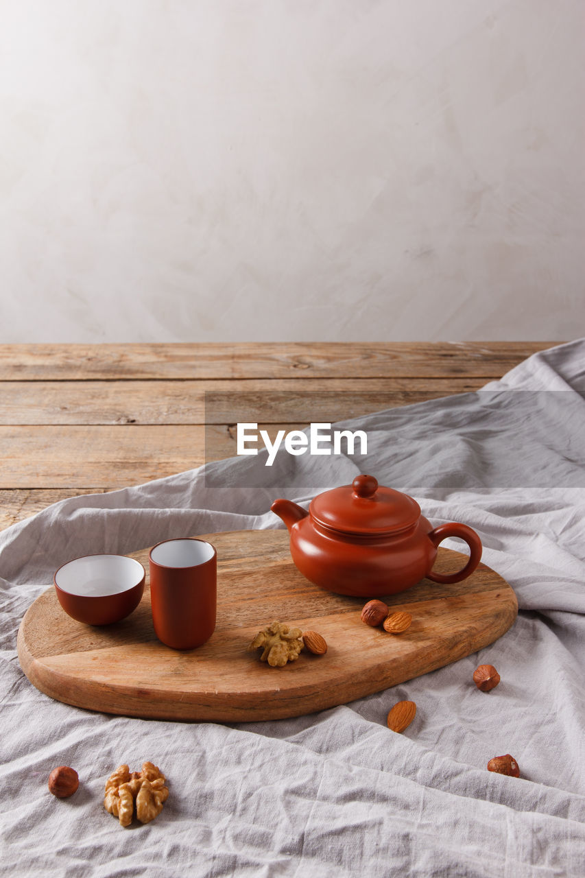 HIGH ANGLE VIEW OF BREAKFAST ON TABLE BY BED