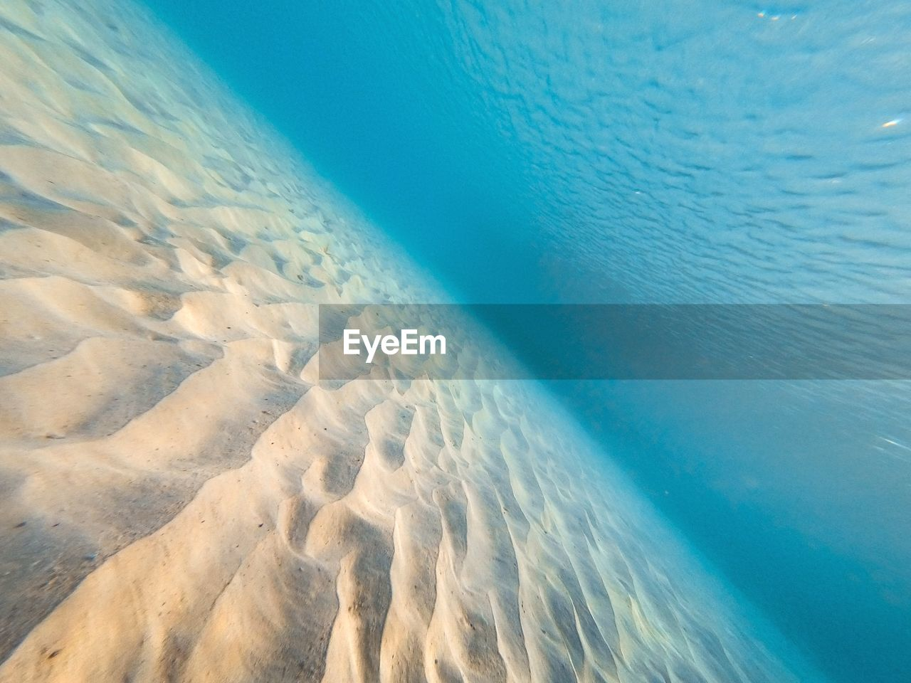 water, sea, beauty in nature, tranquility, scenics - nature, blue, no people, nature, day, sand, land, tranquil scene, beach, idyllic, motion, outdoors, high angle view, close-up, sunlight, turquoise colored, marine