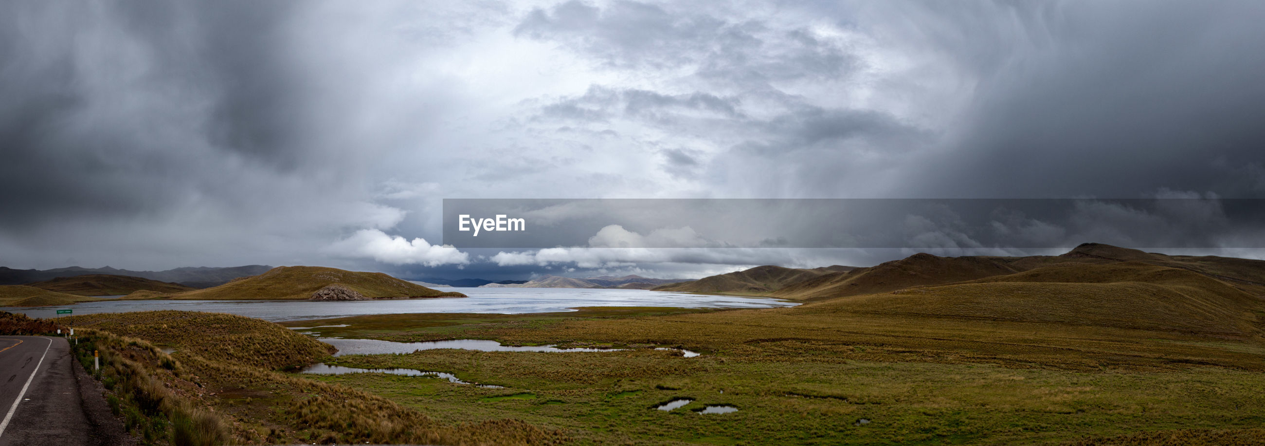 PANORAMIC VIEW OF LAND AGAINST CLOUDY SKY
