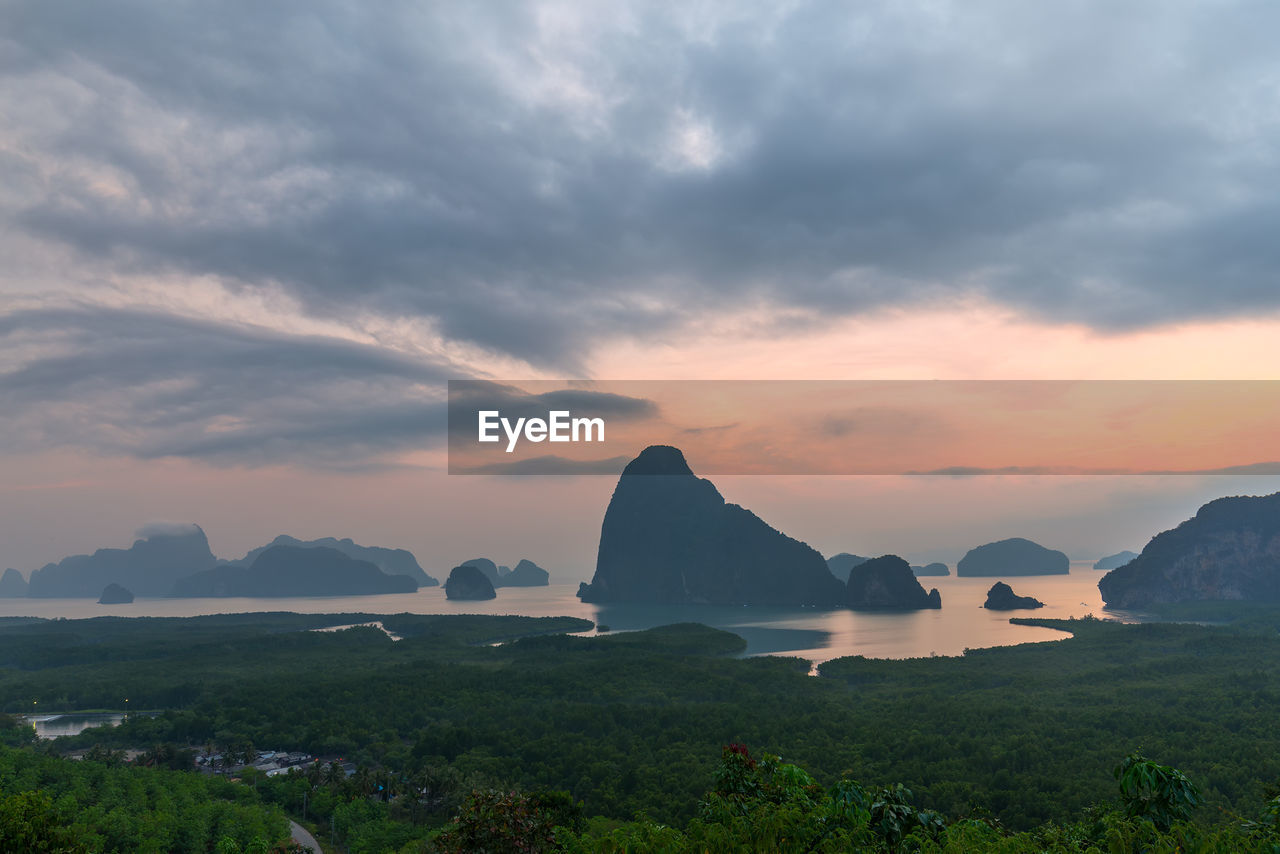 sky, cloud - sky, beauty in nature, scenics - nature, tranquil scene, tranquility, sunset, water, mountain, nature, rock, idyllic, sea, no people, rock - object, rock formation, solid, non-urban scene, land, outdoors, stack rock, mountain peak