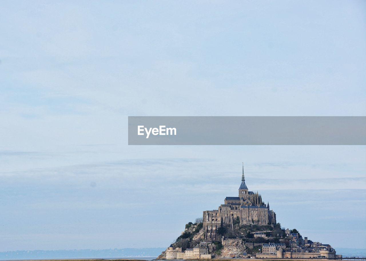 Historic mont saint-michel against sky