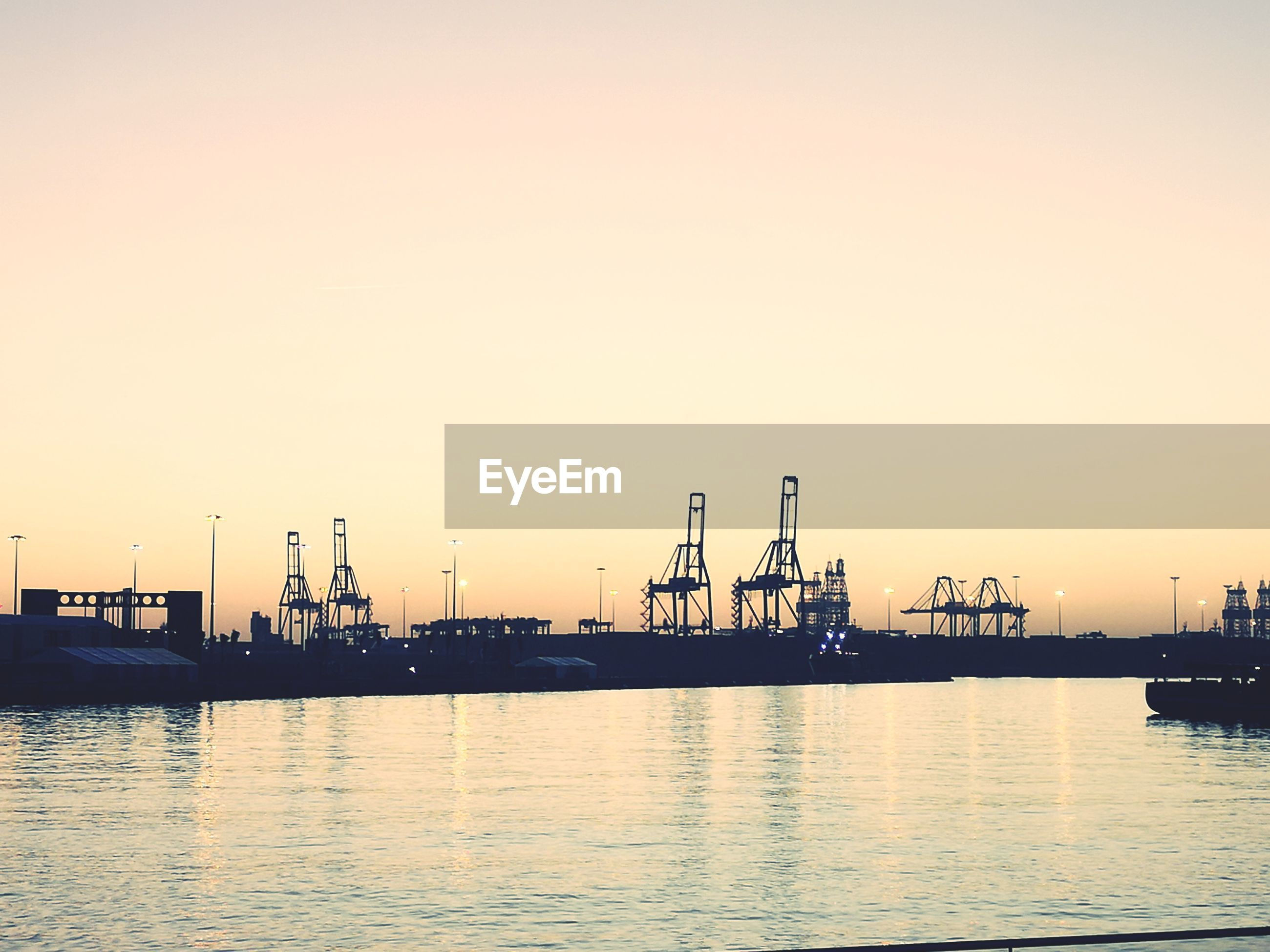 VIEW OF COMMERCIAL DOCK AT SUNSET