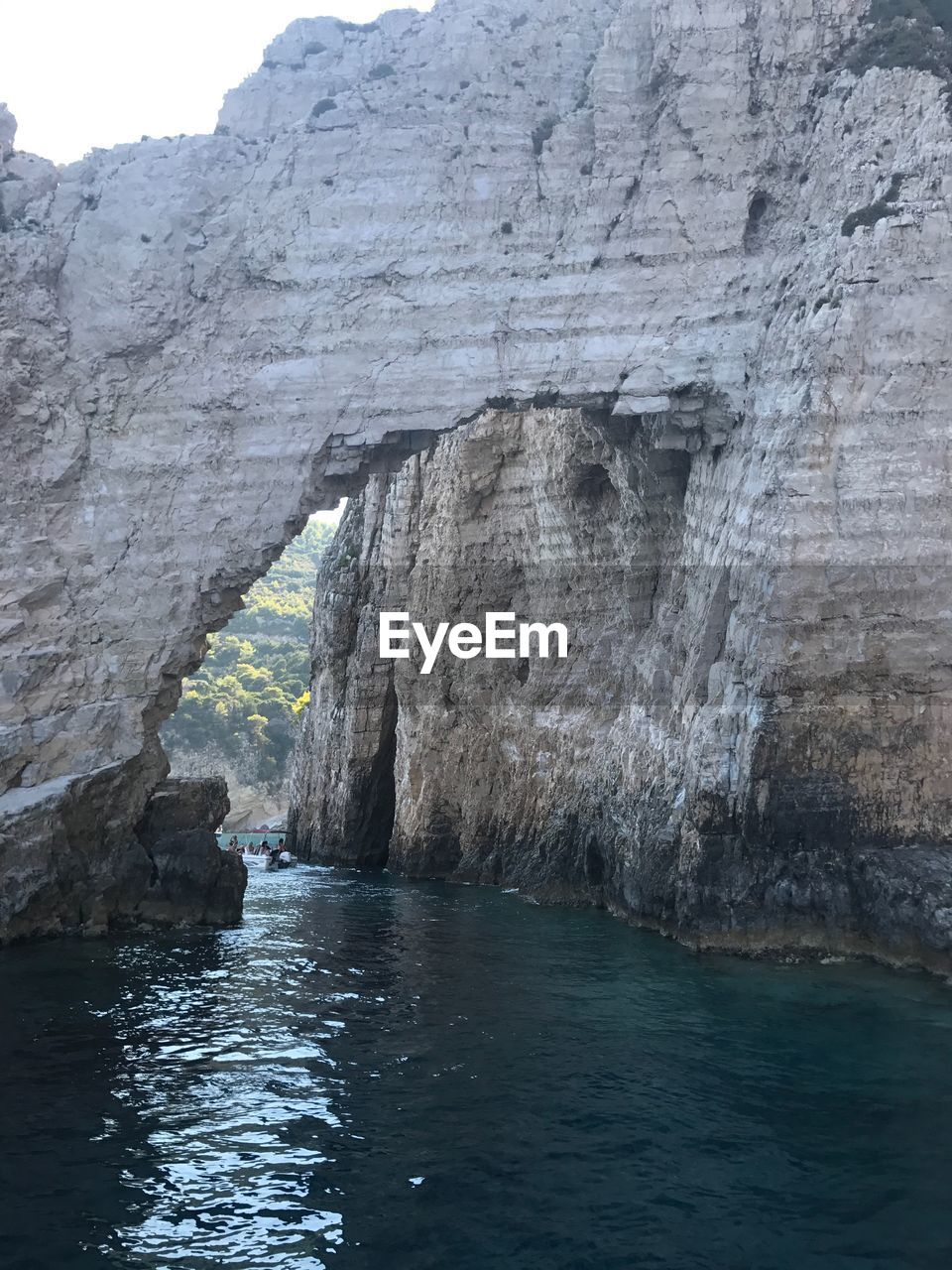 water, rock, rock formation, waterfront, sea, solid, rock - object, beauty in nature, tranquility, nature, no people, scenics - nature, day, tranquil scene, natural arch, arch, non-urban scene, geology, cave, outdoors, eroded, formation
