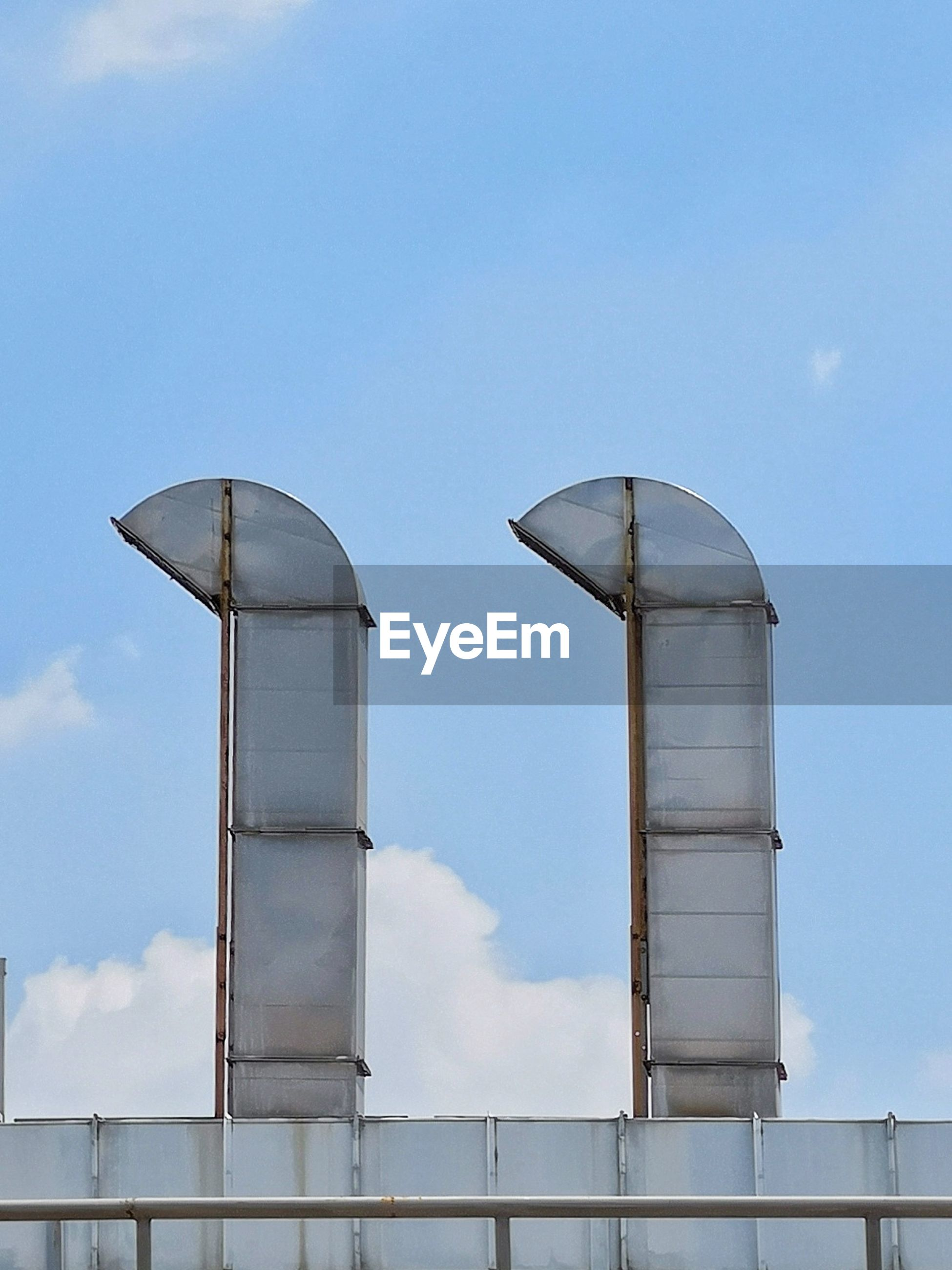 sky, architecture, built structure, low angle view, building exterior, no people, day, nature, cloud - sky, factory, industry, outdoors, blue, metal, building, travel, copy space, tall - high, white color, sunlight