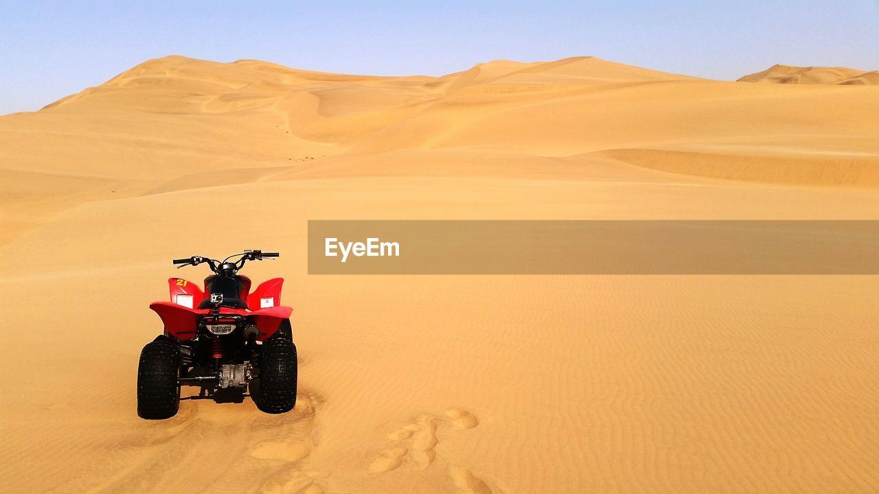 Quadbike Parked On Desert Landscape