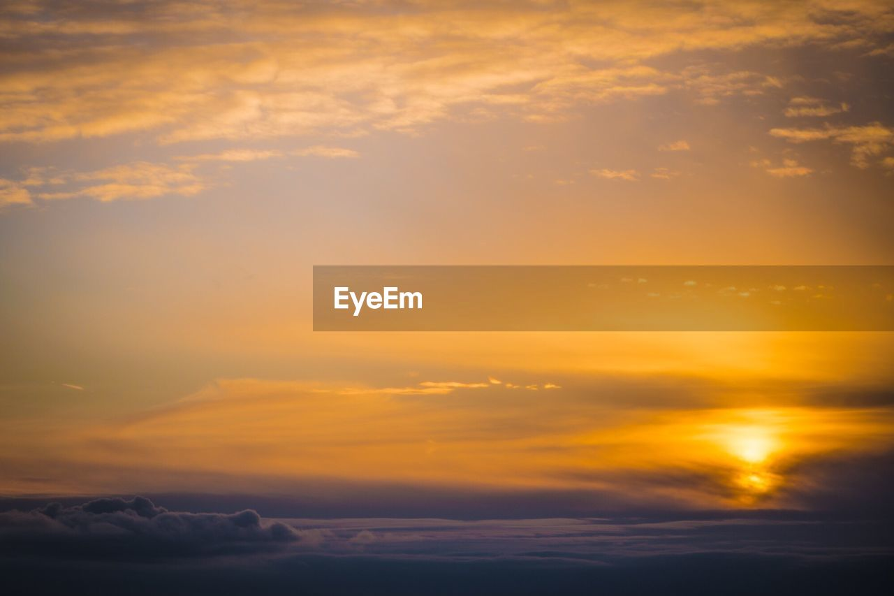 Scenic view of cloudy sky during sunrise