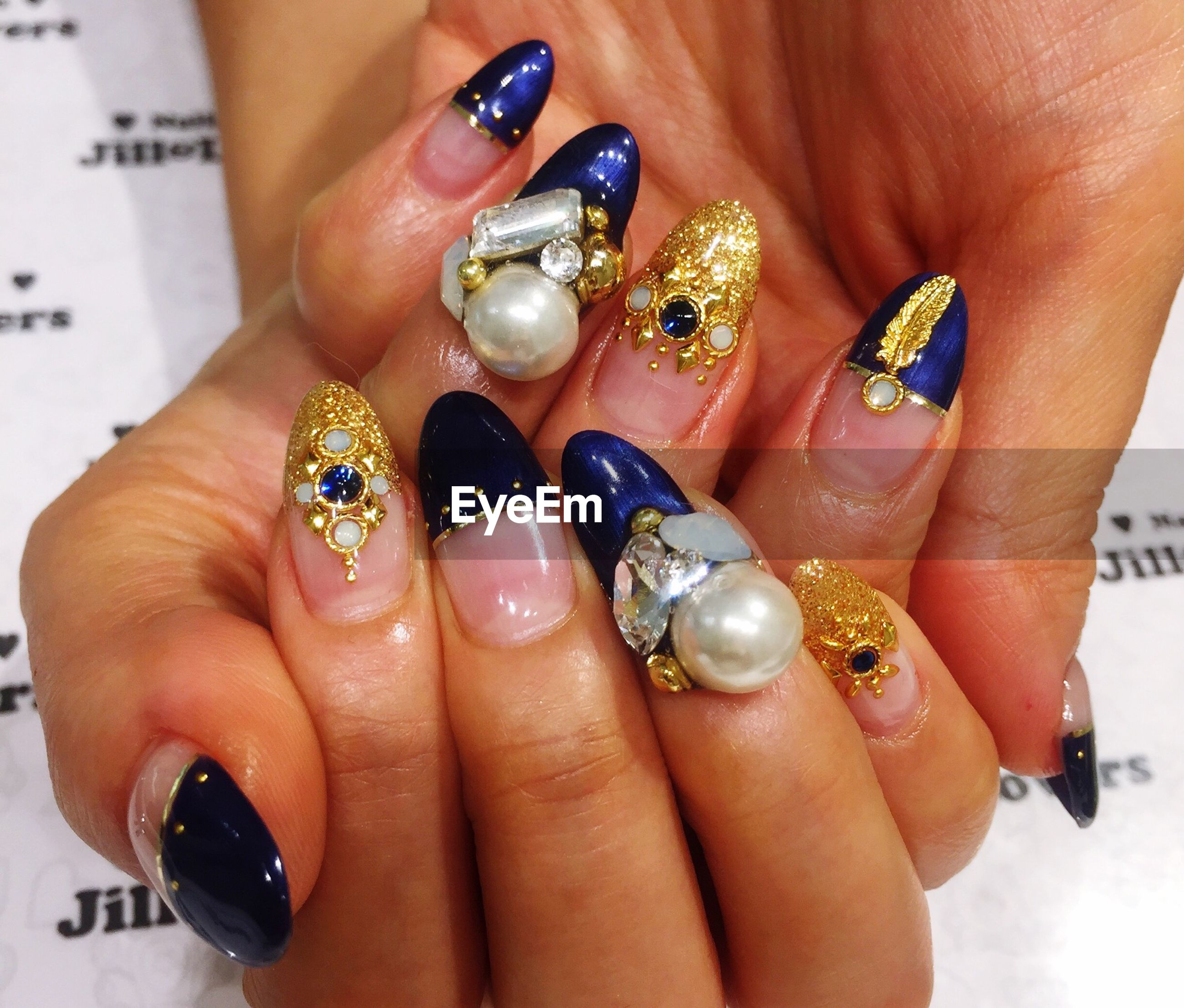 person, part of, holding, human finger, cropped, close-up, ring, nail polish, jewelry, indoors, palm, lifestyles, studio shot, leisure activity, showing, unrecognizable person