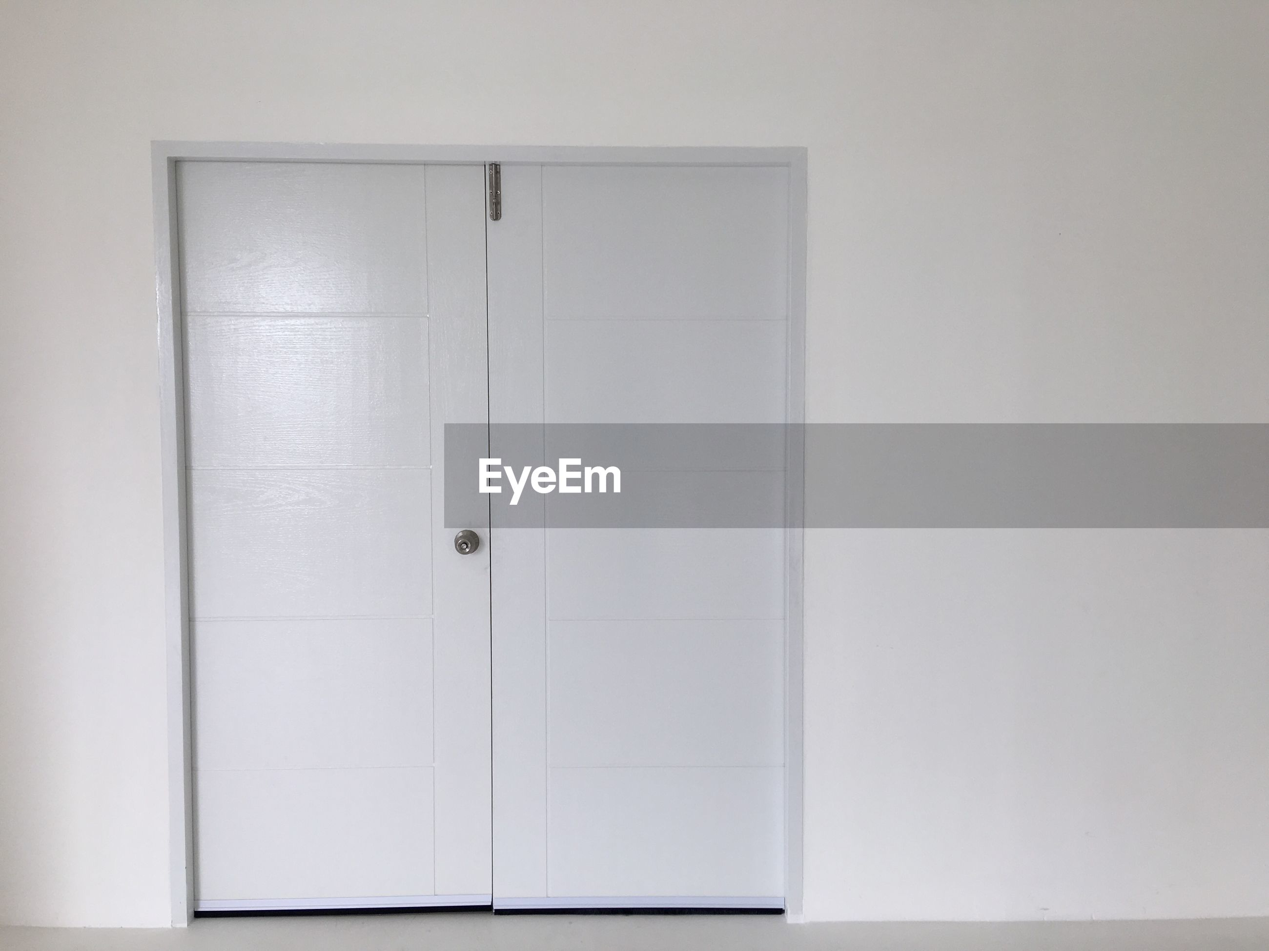Closed white doors at home