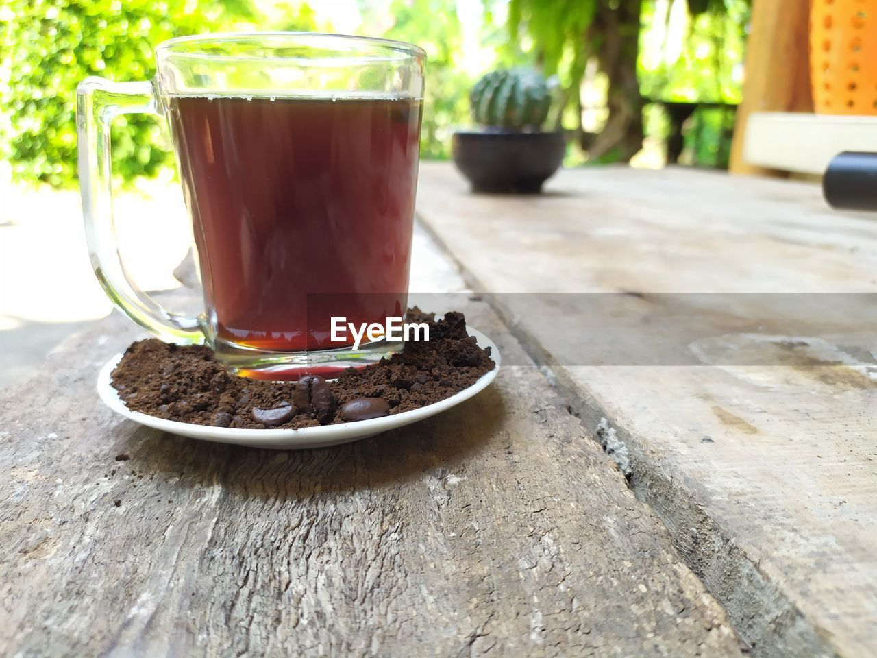 food and drink, table, drink, refreshment, no people, close-up, food, still life, coffee, coffee - drink, freshness, cup, tea, mug, focus on foreground, hot drink, wood - material, leaf, growth, indoors, glass, surface level, crockery