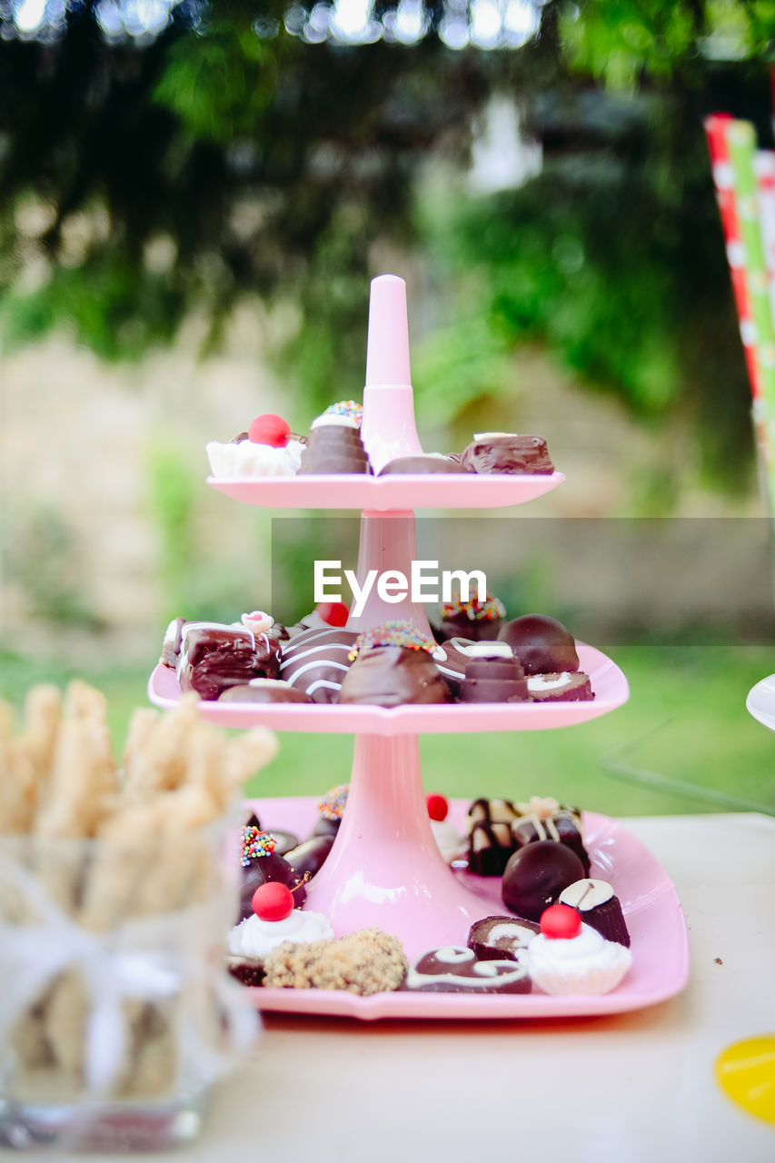 Variety of desserts in cakestand on table
