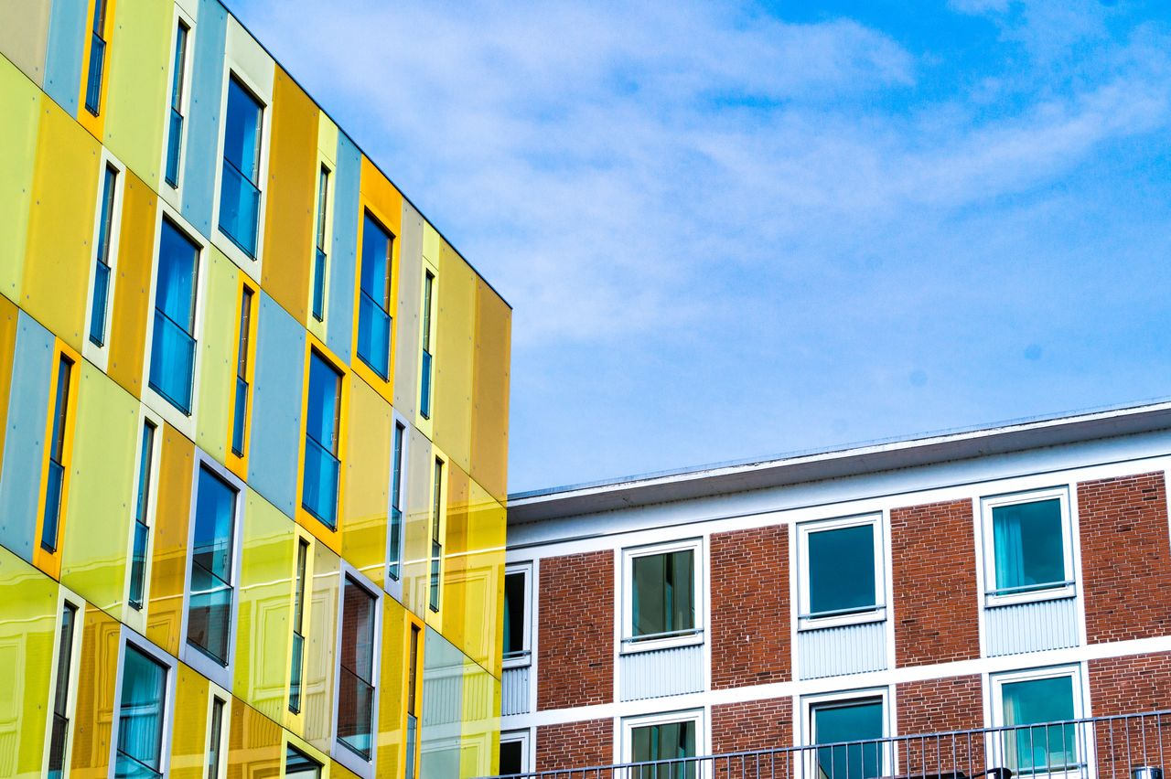 building exterior, architecture, built structure, building, sky, low angle view, window, city, day, cloud - sky, no people, nature, modern, residential district, glass - material, outdoors, blue, office, office building exterior, side by side, apartment