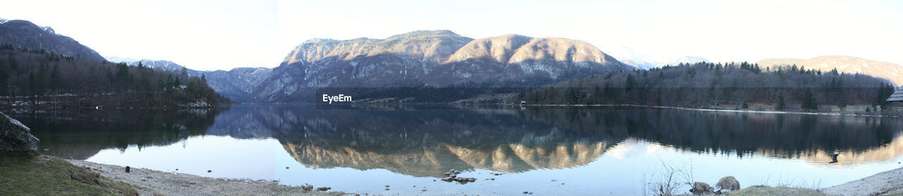 reflection, mountain, beauty in nature, water, tranquility, scenics - nature, lake, tranquil scene, sky, tree, idyllic, non-urban scene, nature, mountain range, day, cold temperature, waterfront, winter, snow, no people, outdoors, reflection lake