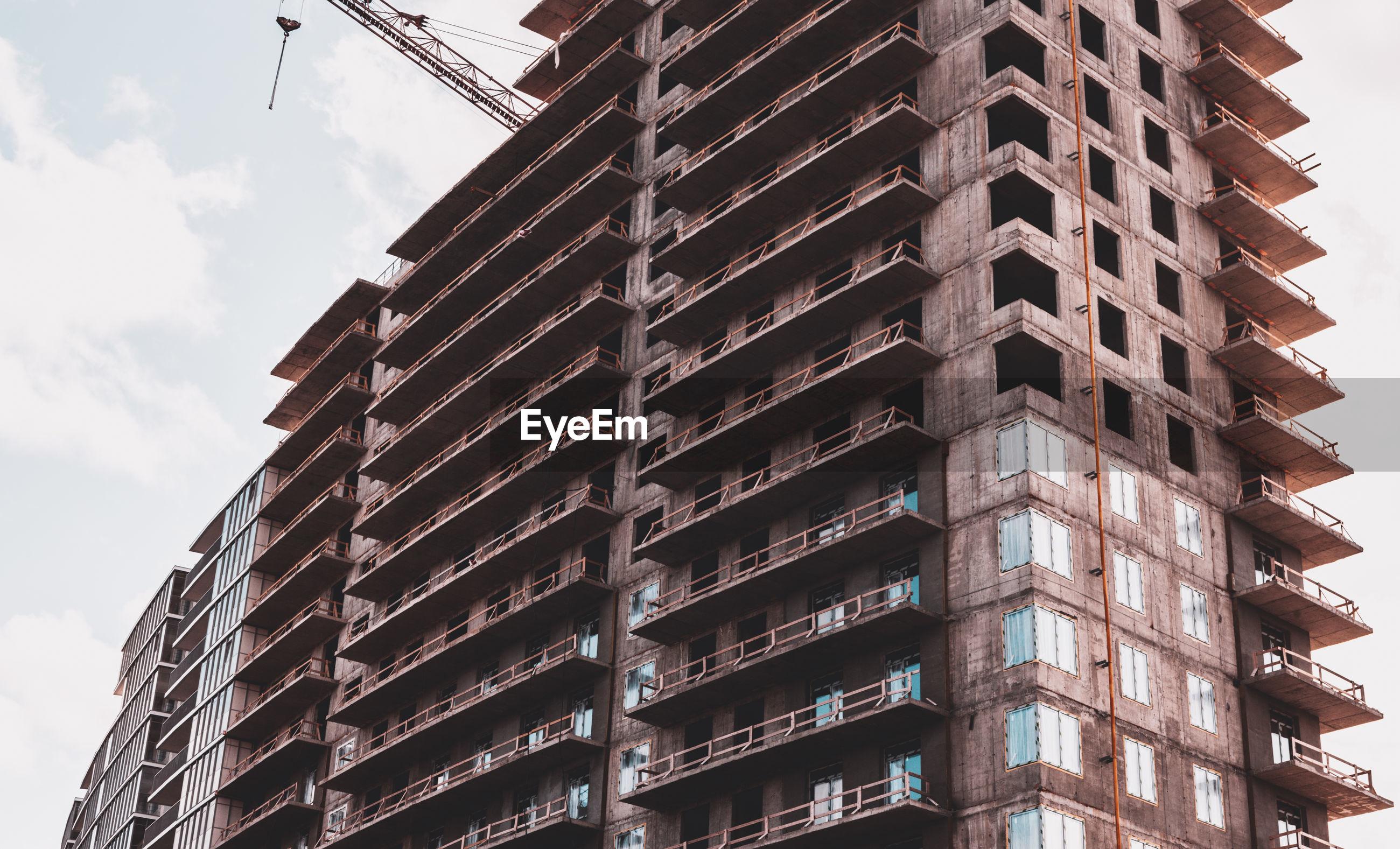 Close-up. skyscraper and building crane at a construction site.