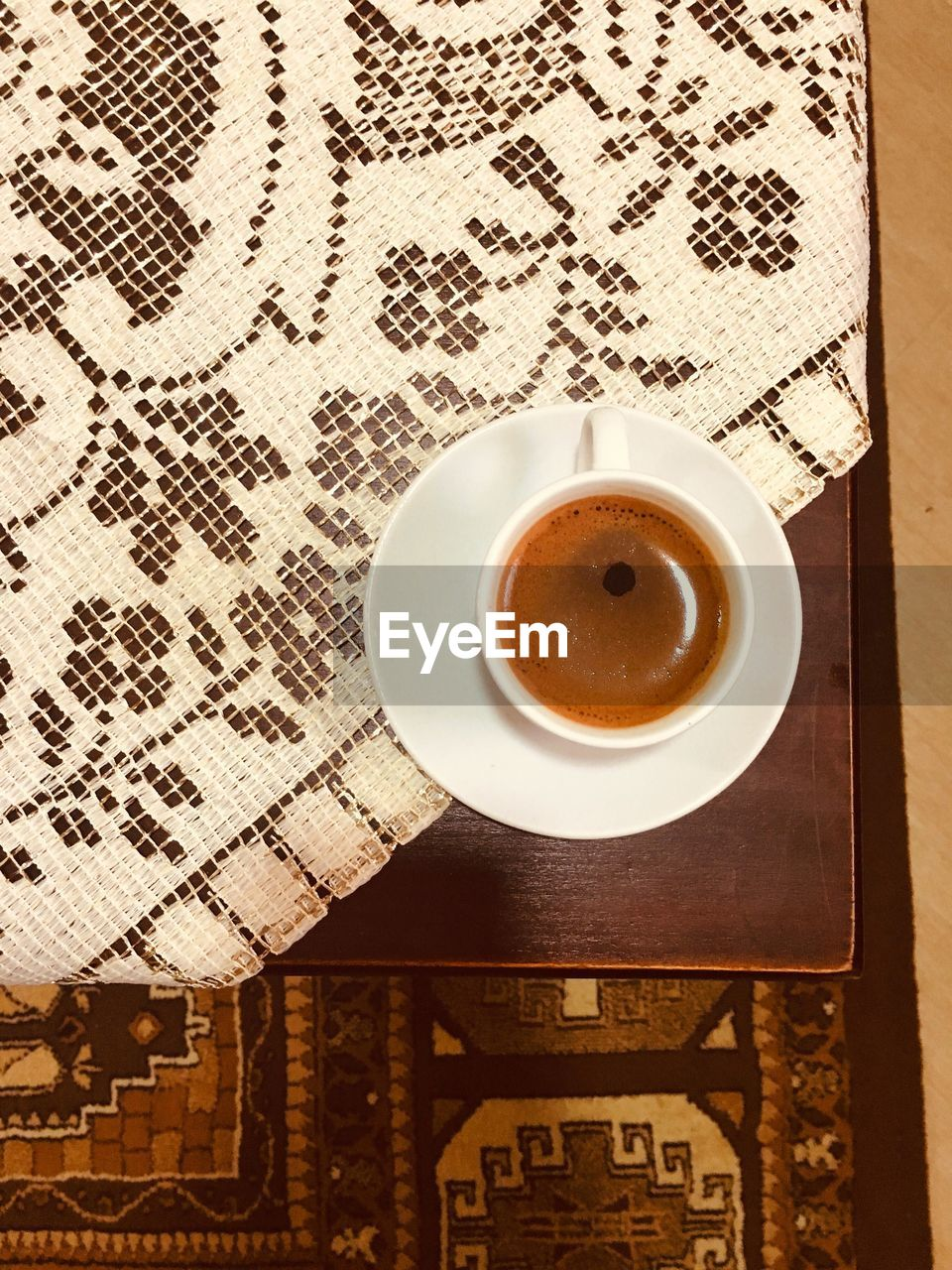 drink, cup, coffee, refreshment, coffee - drink, table, mug, food and drink, coffee cup, indoors, still life, directly above, freshness, no people, high angle view, crockery, hot drink, pattern, saucer, close-up, place mat, non-alcoholic beverage, floral pattern