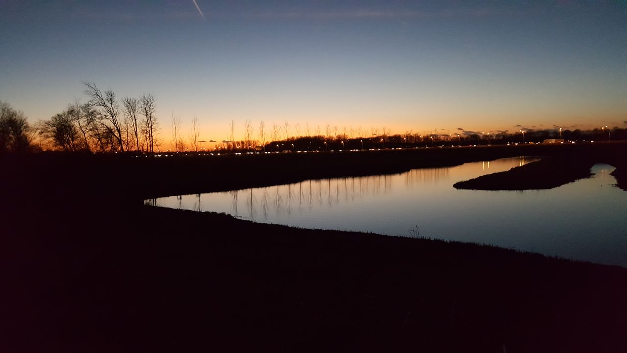 sunset, silhouette, reflection, tranquil scene, nature, water, tranquility, scenics, beauty in nature, lake, sky, standing water, outdoors, no people, tree, clear sky, day