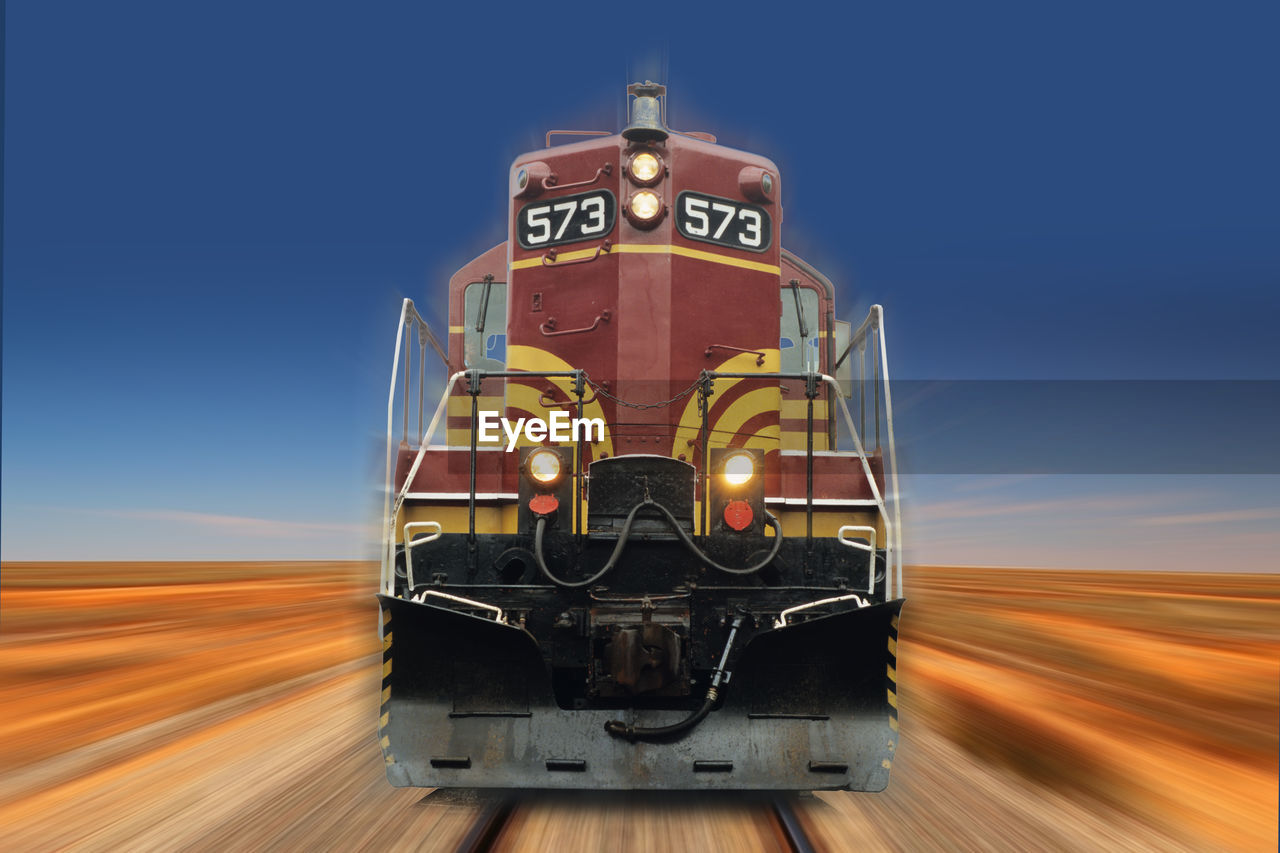 transportation, blurred motion, mode of transportation, motion, speed, sky, no people, clear sky, rail transportation, road, train, train - vehicle, nature, on the move, track, travel, railroad track, land vehicle, blue, day