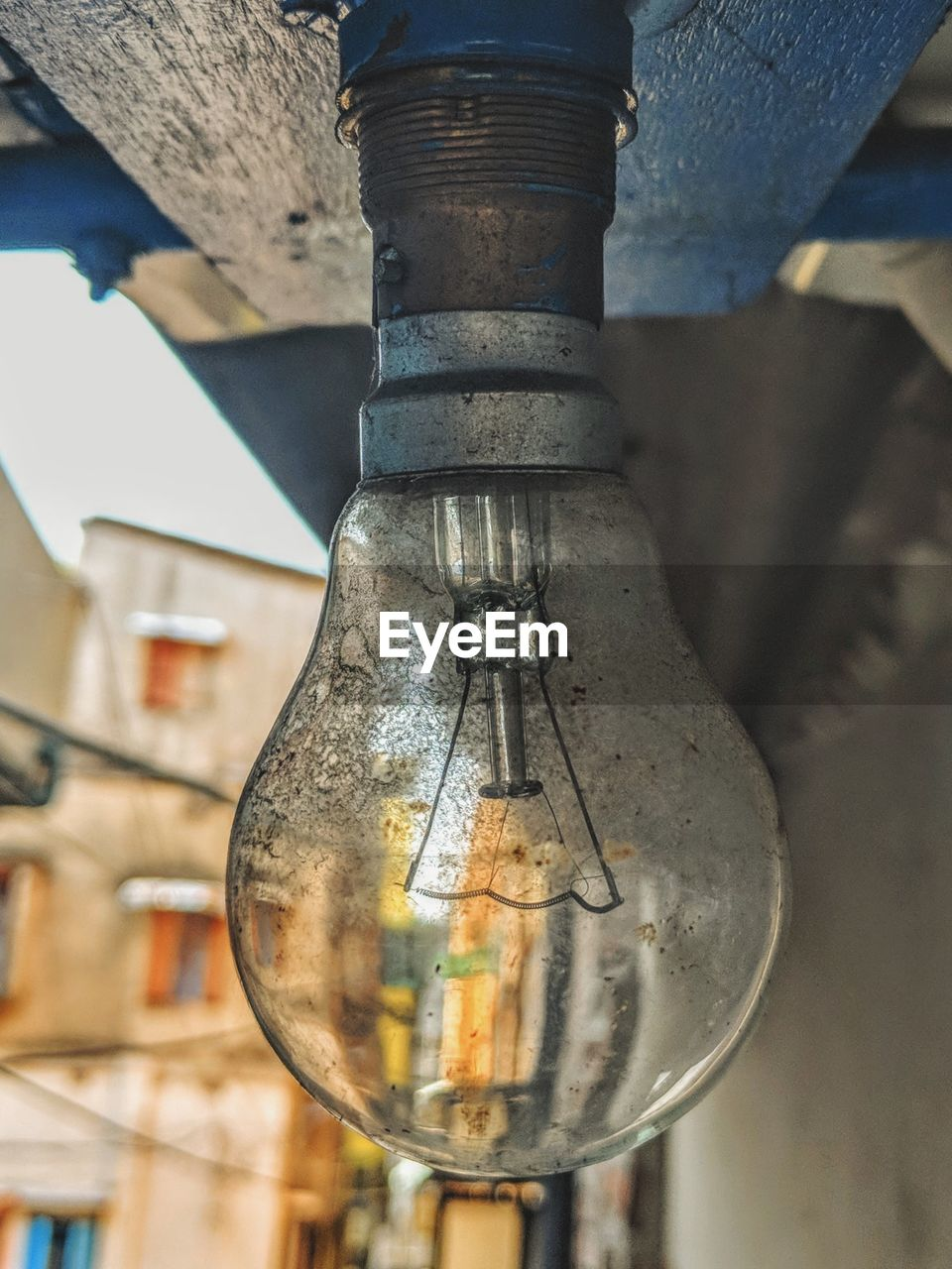 focus on foreground, lighting equipment, close-up, no people, light bulb, glass - material, old, metal, hanging, indoors, electricity, architecture, day, transparent, electric light, built structure, fuel and power generation, lantern, electric lamp
