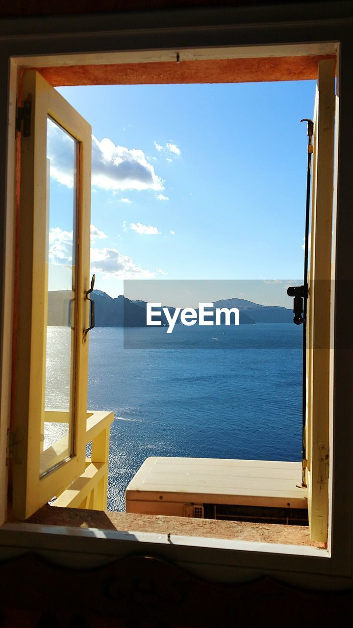 window, sky, water, sea, indoors, mountain, day, no people, nature, transparent, scenics - nature, glass - material, beauty in nature, tranquil scene, tranquility, architecture, sunlight, nautical vessel, window frame