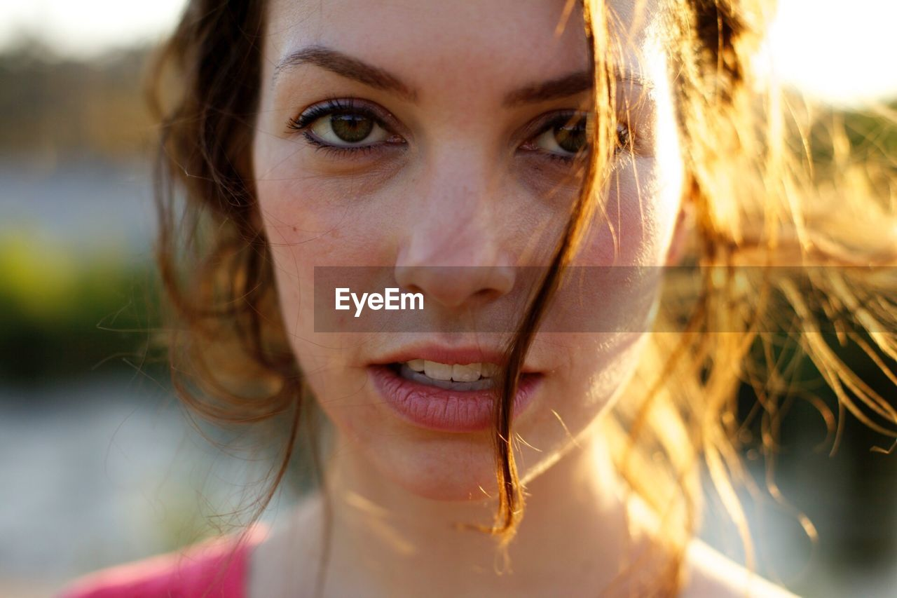 Extreme close up portrait of a content young woman
