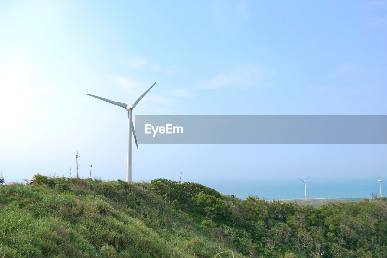 fuel and power generation, turbine, wind turbine, environment, environmental conservation, wind power, alternative energy, renewable energy, sky, landscape, nature, land, plant, field, technology, day, rural scene, beauty in nature, no people, grass, sustainable resources, outdoors, power in nature, power supply