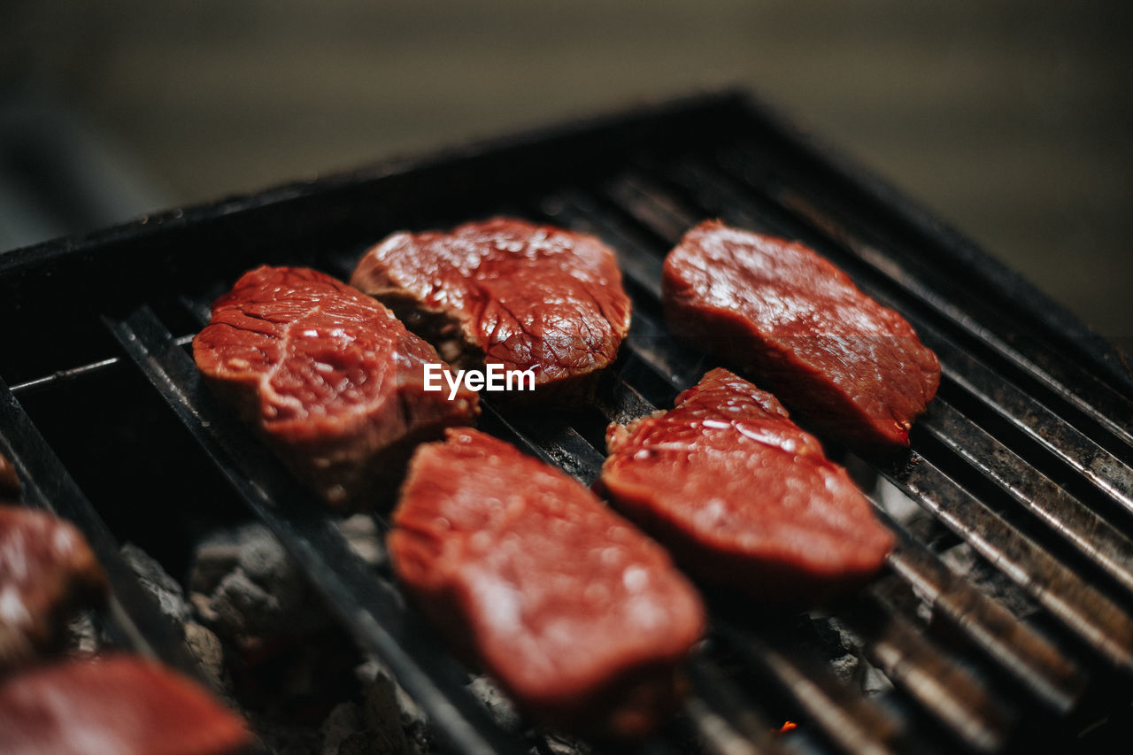 Close-up of raw meat on barbecue grill