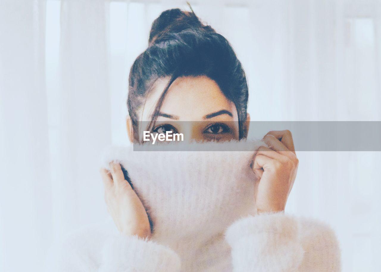 Close-Up Portrait Of Woman Wearing Turtleneck Sweater