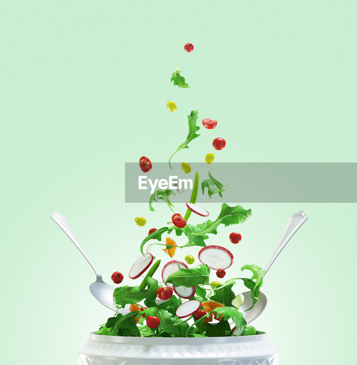 Close-Up Of Vegetables In Mid - Air Over Container Against Green Background