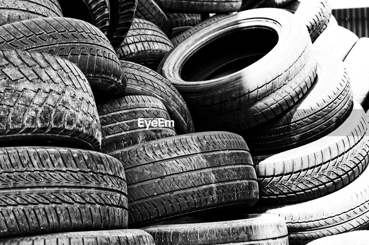 stack, tire, wheel, rubber, large group of objects, no people, still life, backgrounds, group of objects, day, pattern, transportation, close-up, abundance, full frame, container, old, repetition, automobile industry, outdoors
