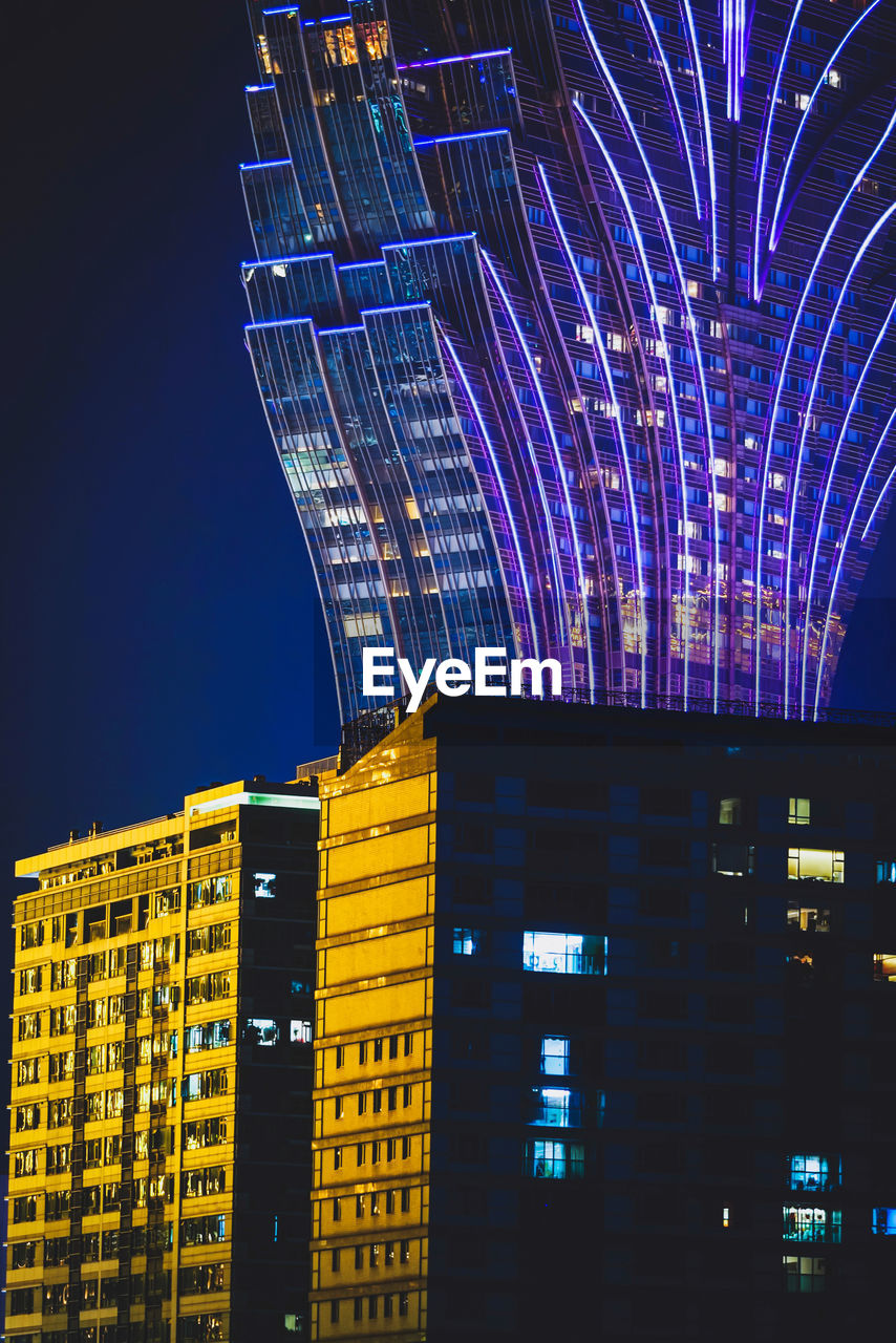 building exterior, built structure, illuminated, architecture, night, city, building, sky, low angle view, office building exterior, no people, modern, office, nature, skyscraper, tall - high, tower, outdoors, clear sky, glowing, financial district