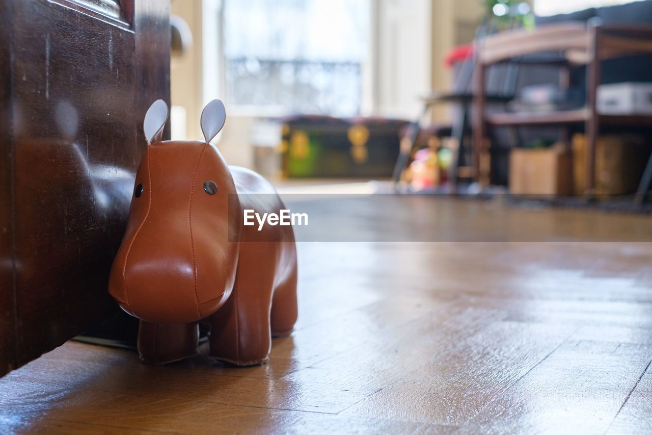 Close-up of toy on hardwood floor at home