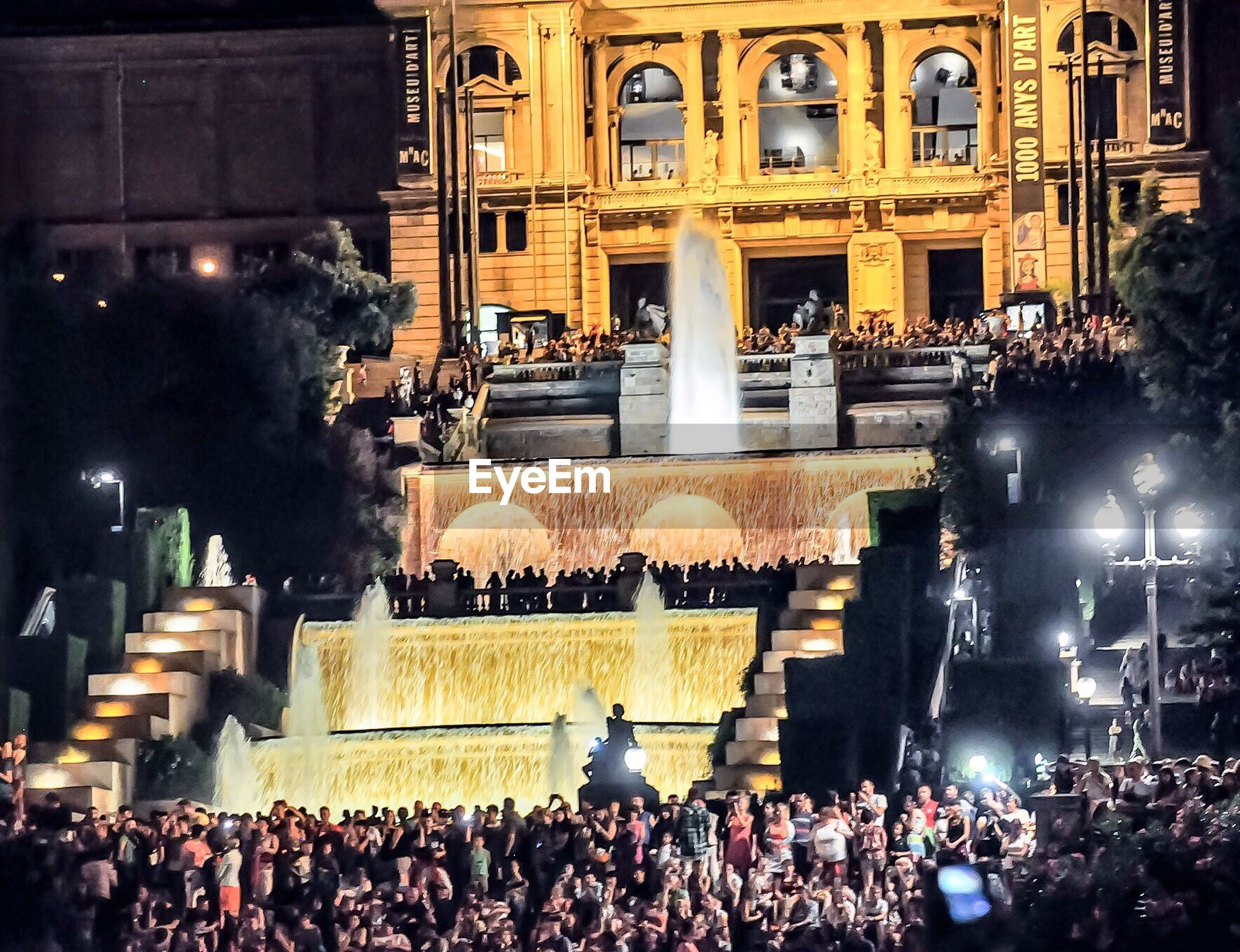 High angle view of crowd against illuminated building at night