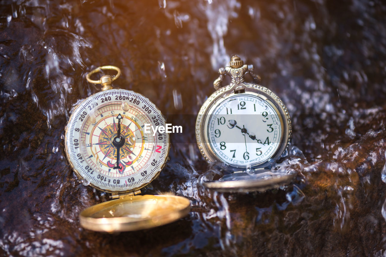 no people, number, pocket watch, still life, close-up, antique, accuracy, time, selective focus, indoors, clock, watch, metal, nature, high angle view, shape, table, navigational compass, instrument of time